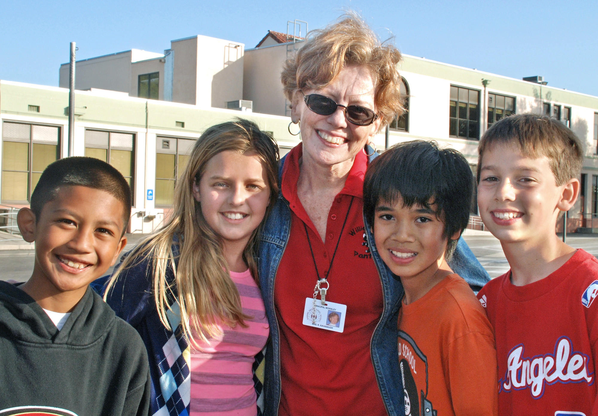 McKinley Elementary principal Principal Bobbie Kavanaugh will retire after 38 years as an educator at the end of the school year. She is pictured with McKinley Elementary students from left, Jared Pasion, Ashley Samuel, Leander Benedicto and Justice Howe.