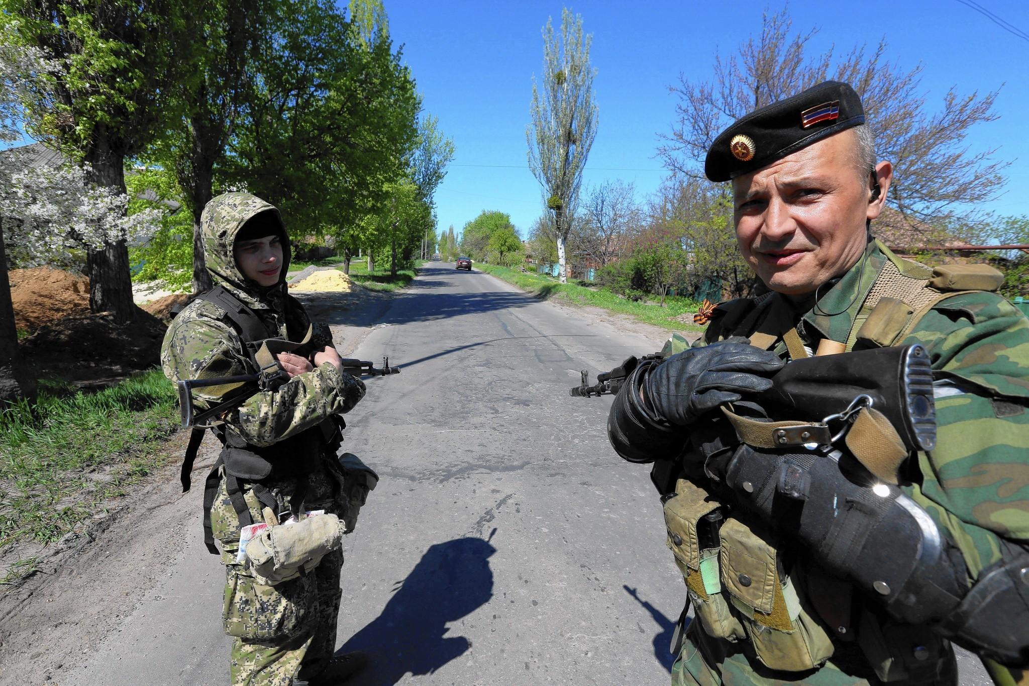A Russian gunman who goes by the codename Popeye, right, patrols the streets of Slovyansk, Ukraine.