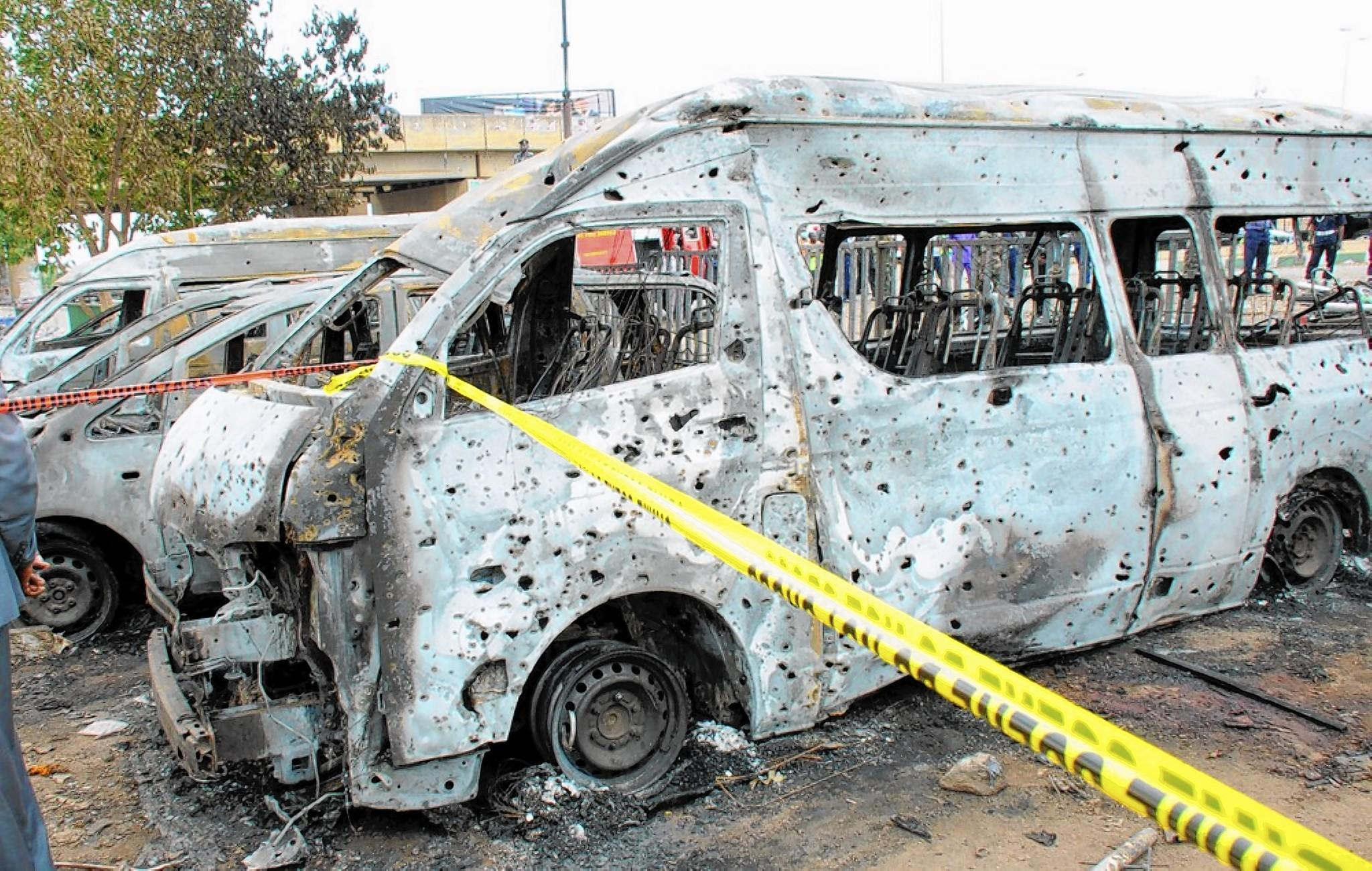 Burned vehicles sit at a bus station in Abuja, Nigeria, that was attacked April 14, apparently by the militant group Boko Haram. The suicide bombing killed 71 civilians.