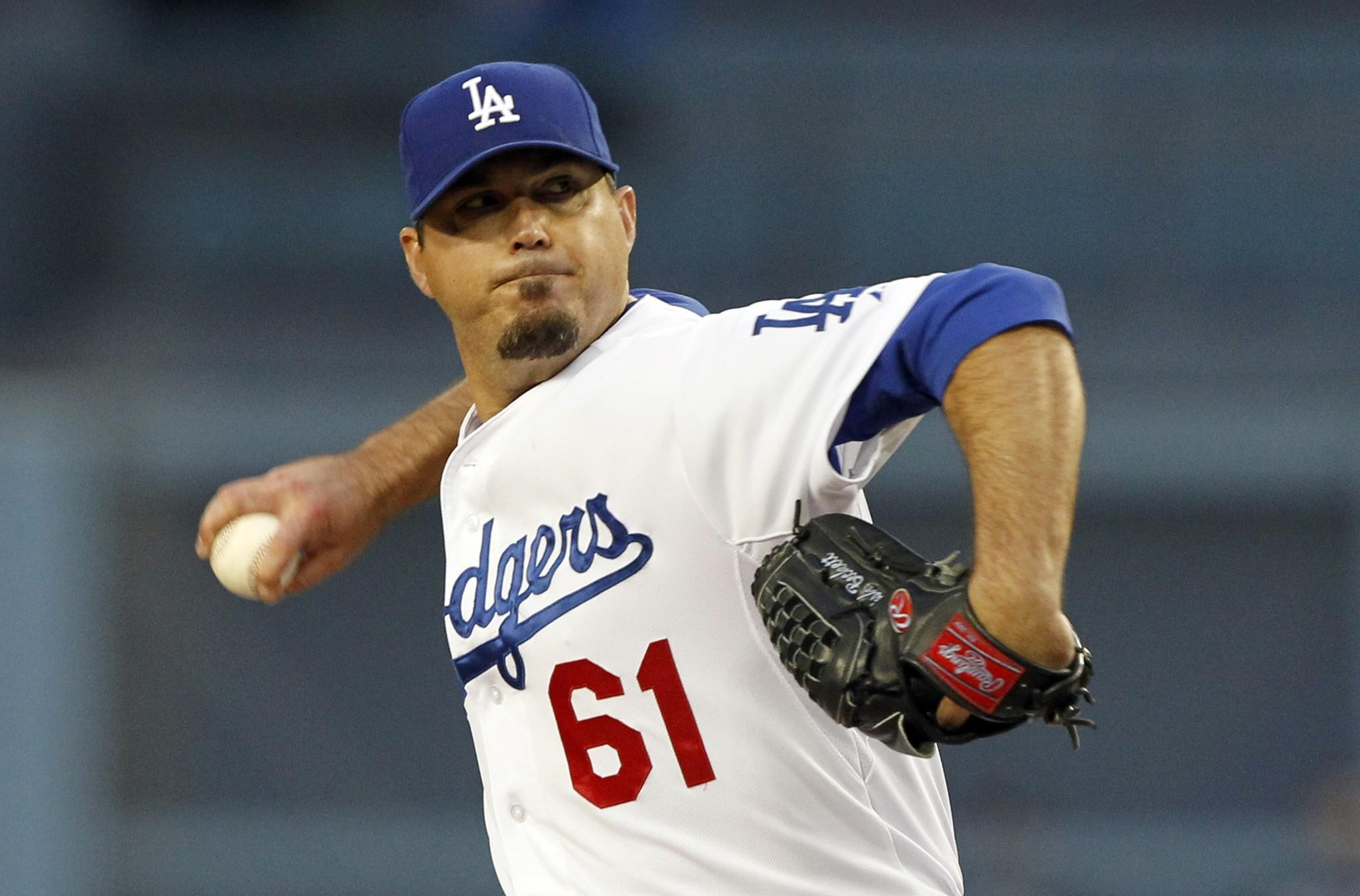Josh Beckett gave up two earned runs on four hits over eight innings while striking out two batters against the Colorado Rockies on Friday at Dodger Stadium.