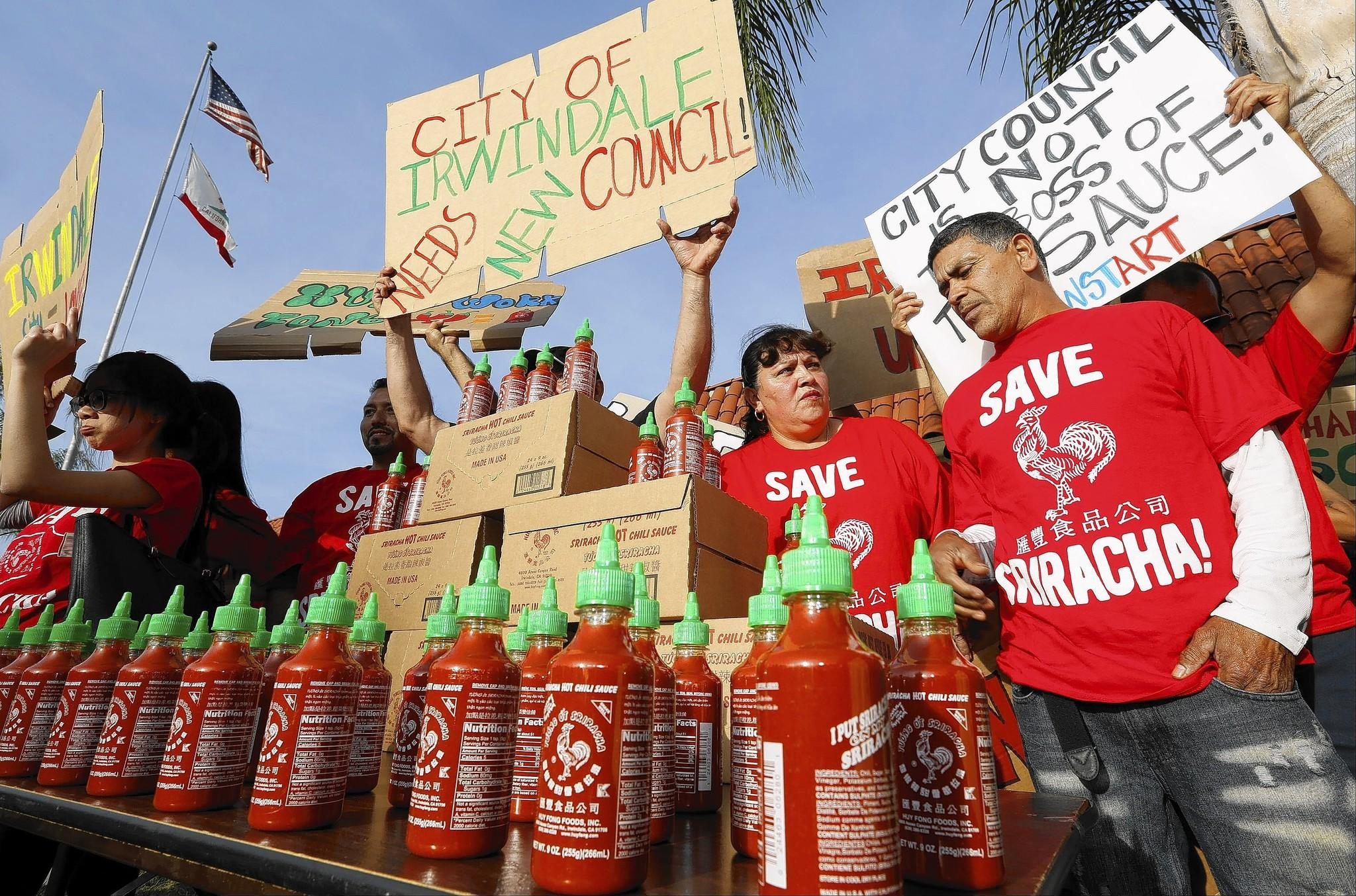 Sriracha hot sauce workers protest before the start of the Irwindale City council meeting. The council previously drafted a resolution declaring Sriracha a public nuisance because of the burning smell coming from its plant.