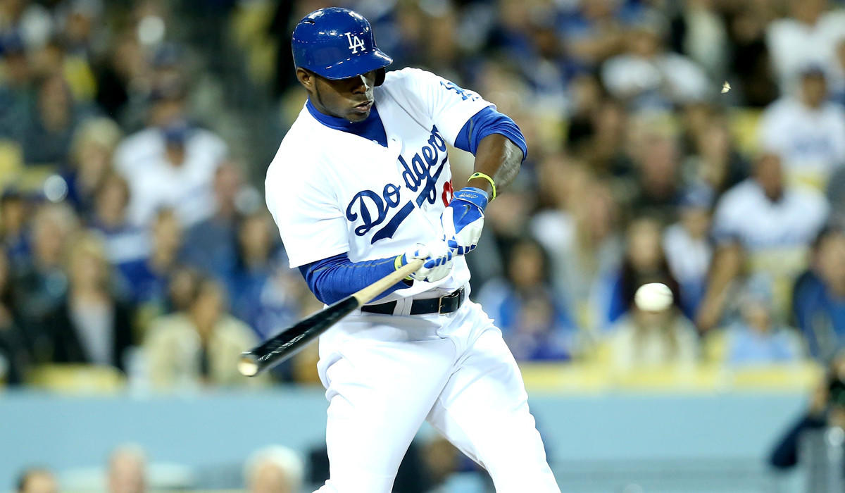 Dodgers right fielder Yasiel Puig connects for a run-scoring single in the third inning against the Rockies on Friday night at Dodger Stadium.