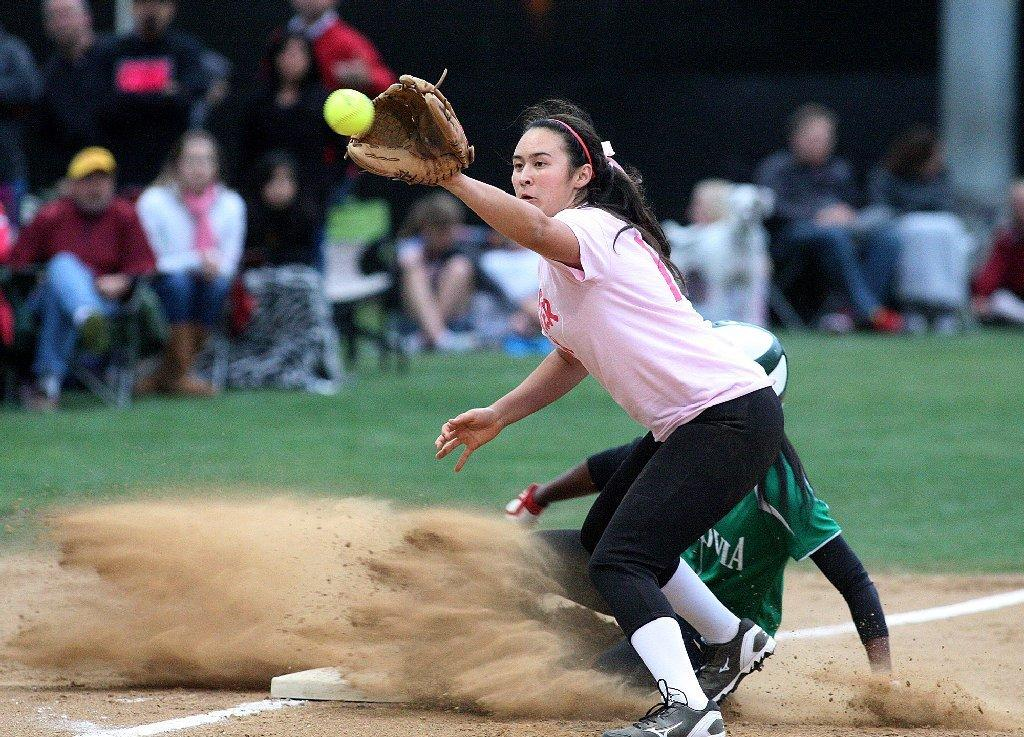La Cañada High's Sammy Jedrey, at third base, receives the throw from home late as Monrovia's Derek Blow slides safely into third base in a Rio Hondo League softball game at La Cañada High on Friday. (Tim Berger/Staff Photographer)