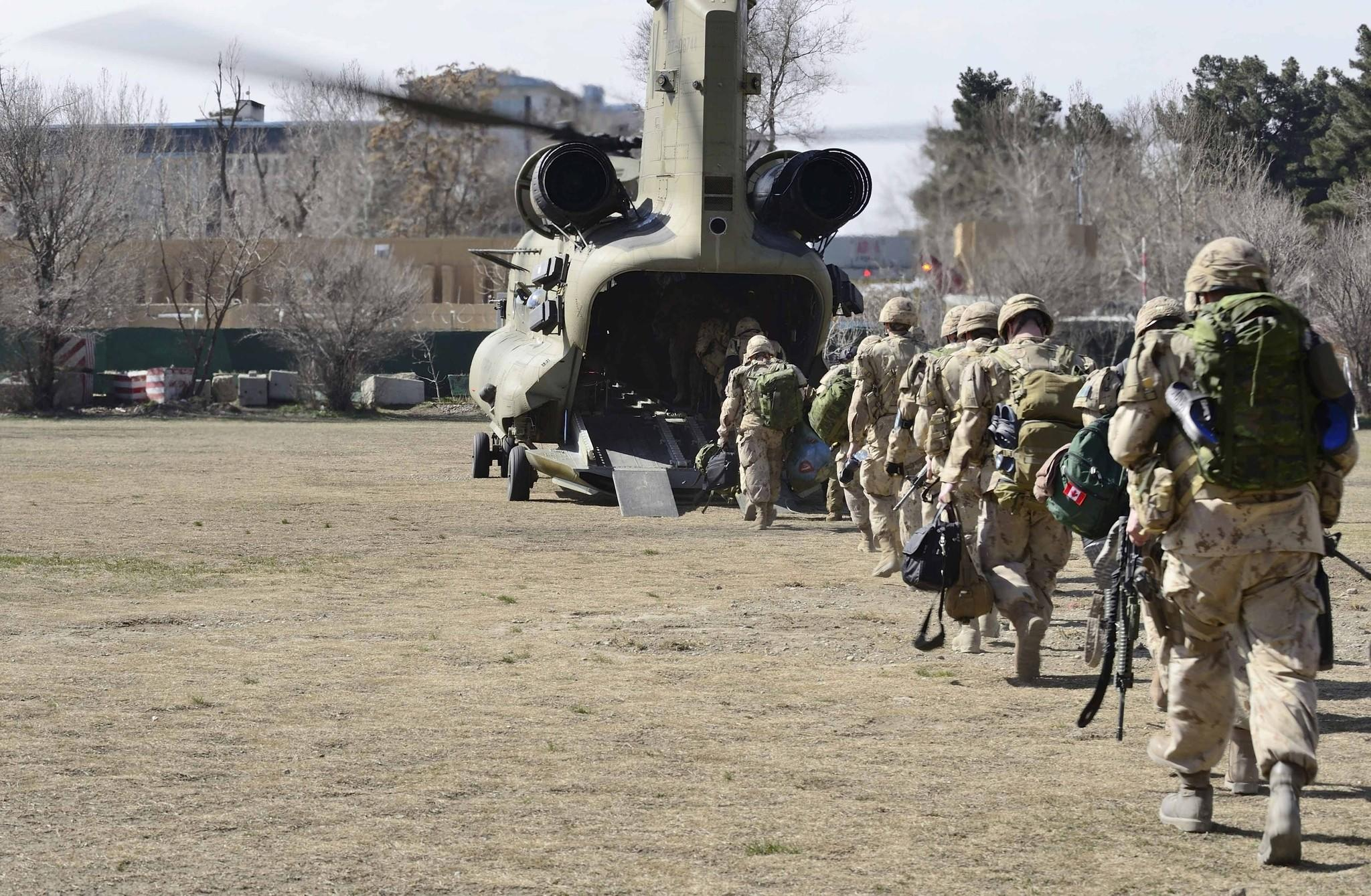 NATO troops board an American Chinook helicopter in March as they leave the International Security Assistance Force headquarters in Kabul, Afghanistan.