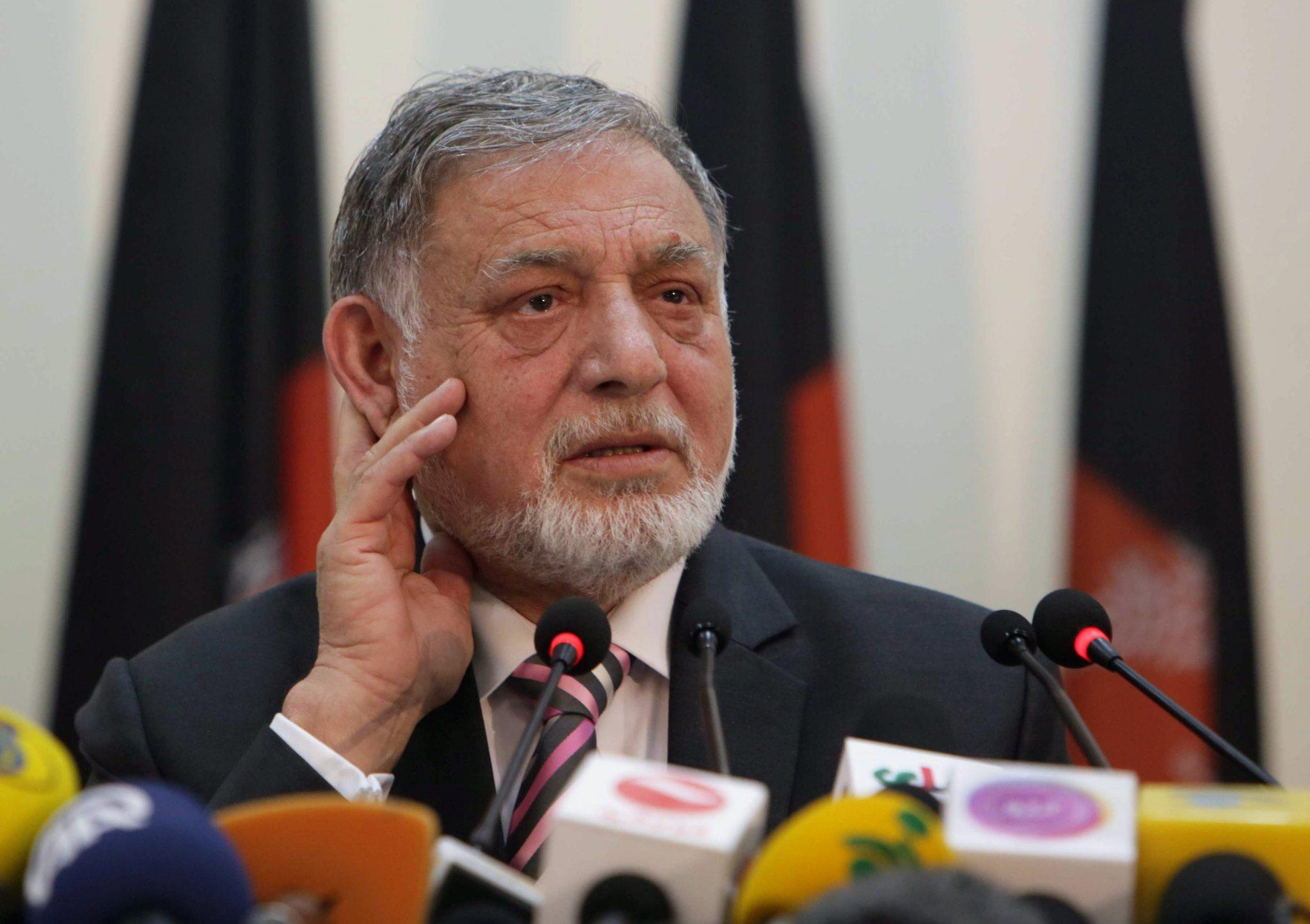 Ahmad Yusuf Nuristani, head of the Independent Election Commission, announces result of the first round of Afghanistan's presidential vote in Kabul on Saturday.