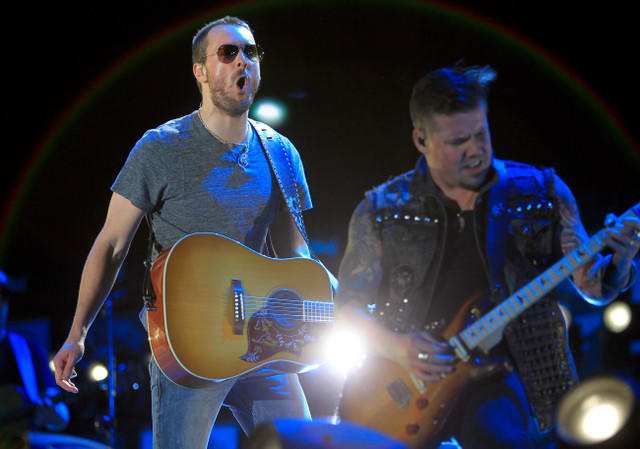 Eric Church, left, performs Friday night at the Stagecoach Country Music Festival in Indio.