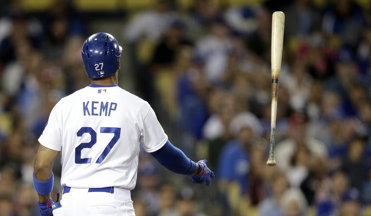 Dodgers center fielder Matt Kemp tosses his bat after striking out against the Phillies on Thursday night.