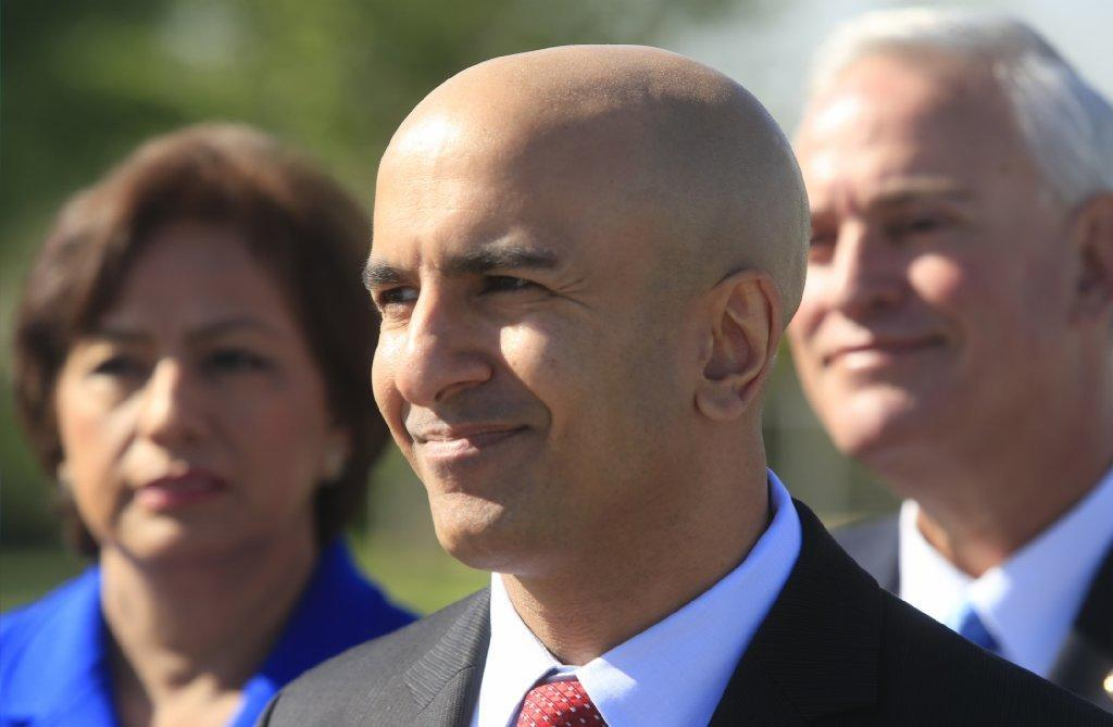 Republican gubernatorial candidate Neel Kashkari, center, at a news conference in Downey last month.