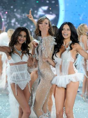 From left, Lily Aldridge, Karlie Kloss and Adriana Lima walk the runway at the 2013 Victoria's Secret Fashion Show in New York.