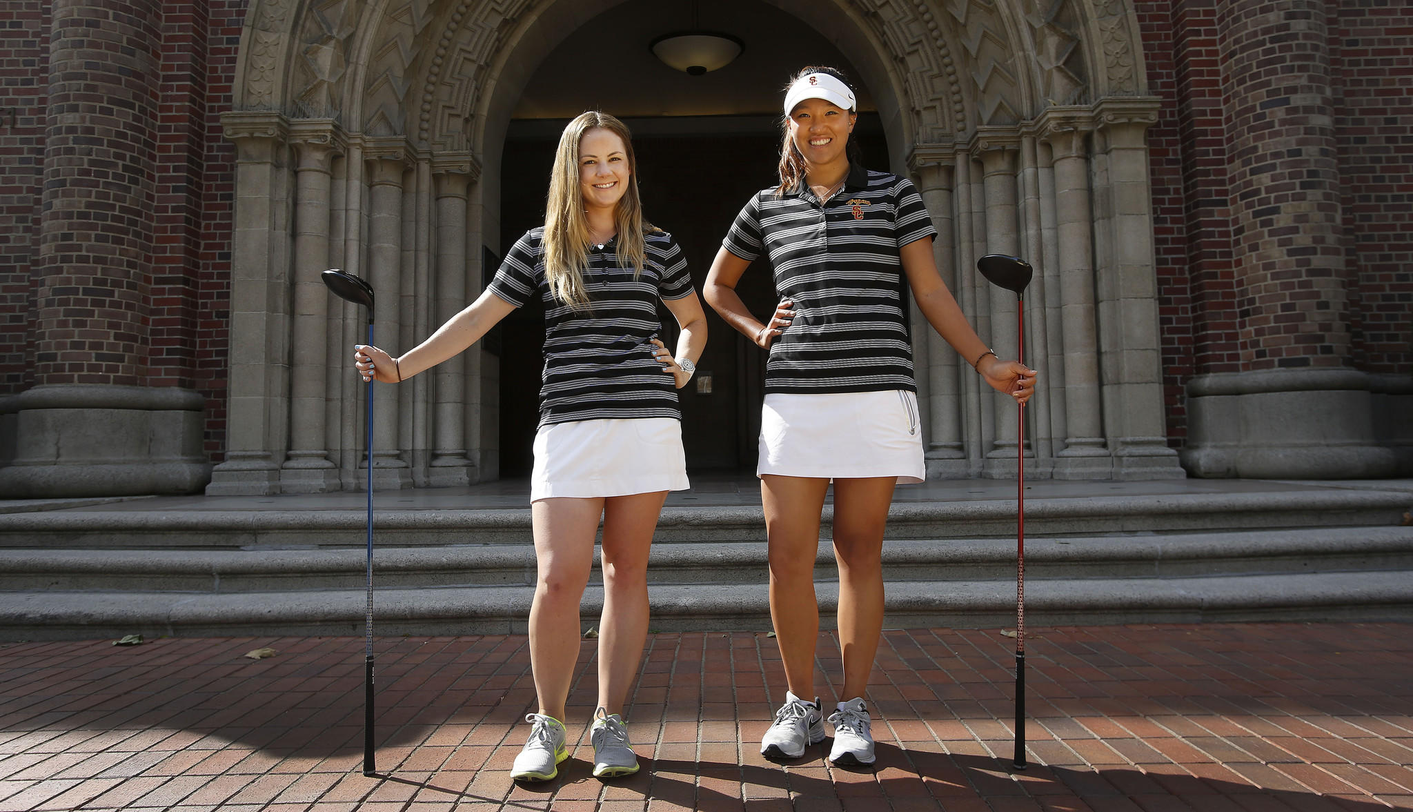 USC women's golfers Rachel Morris, left, and Annie Park played leading roles in lifting the Trojans to the 2013 NCAA championship. They are also excel academically.