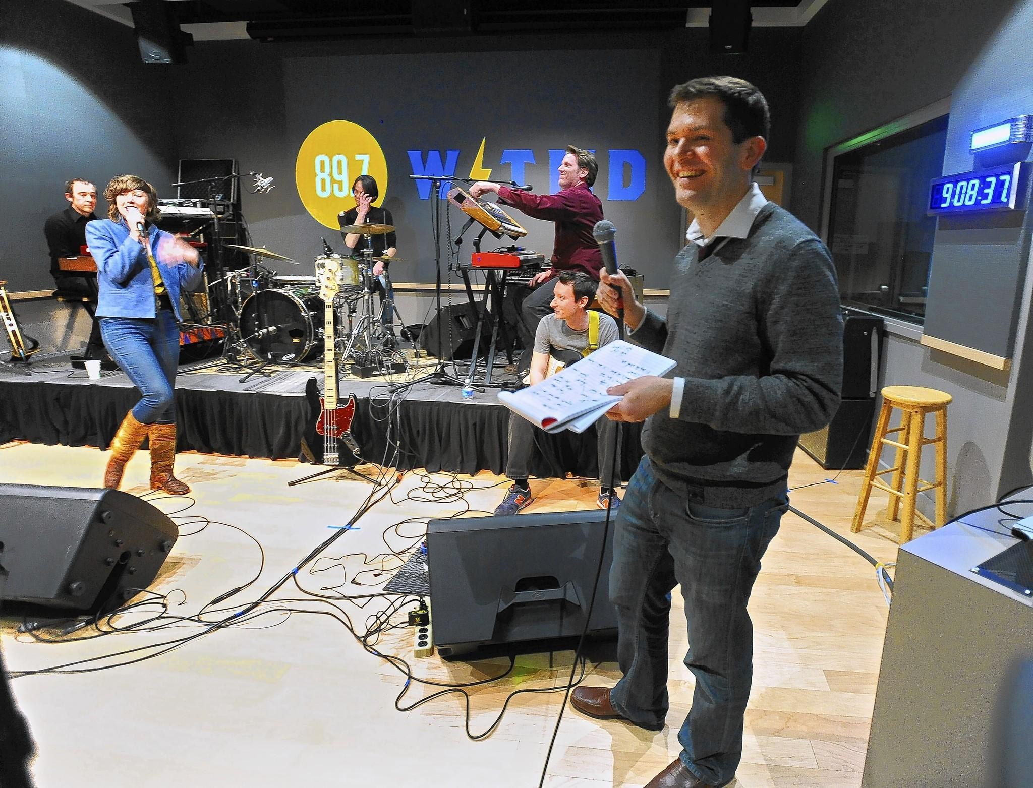 Public radio station WTMD broadcasts a live on-air show complete with studio audience at its new location in Towson. The Baltimore Hit Parade show host Sam Sessa, right, interviews members of the local band Celebration after one of their songs in the show.