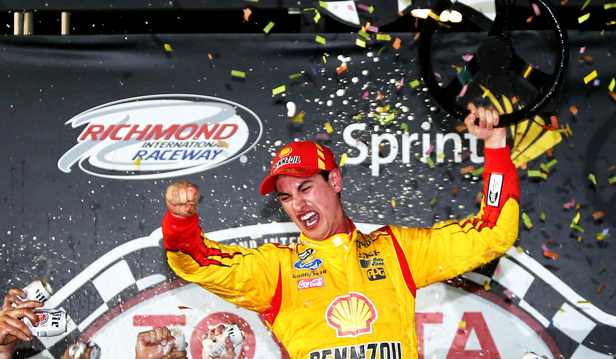 NASCAR driver Joey Logano celebrates in Victory Lane after winning the Sprint Cup Series Toyota Owners 400 at Richmond International Raceway on Saturday night.