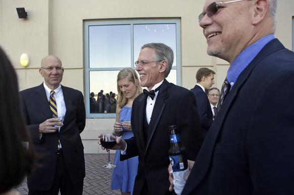 David Teel, center, talks with guests during a reception before being inducted into the Virginia Sports Hall of Fame Saturday evening at the Renaissance Portsmouth Hotel and Waterfront Convention Center.