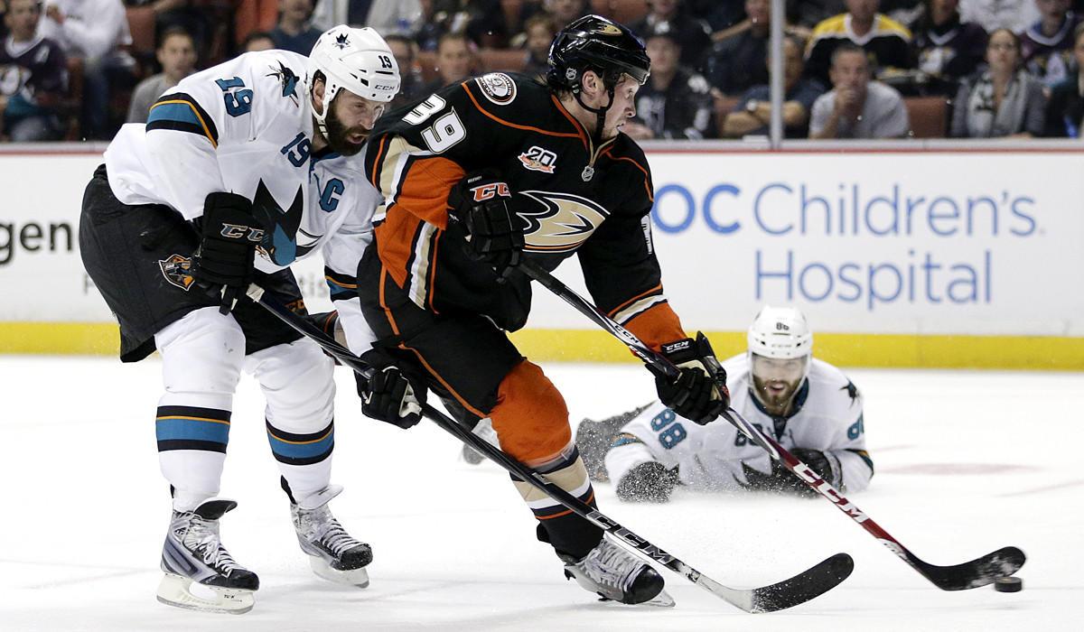 Ducks forward Matt Beleskey (39) shoots and scores in front of the Sharks' Joe Thornton (19) and Brent Burns (88) during a regular-season game.