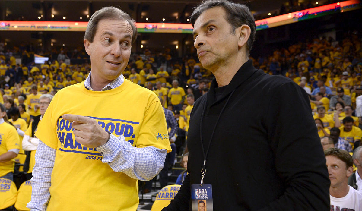 Warriors owner Joe Lacob, left, chats with Kings owner Vivek Ranadive before Game 3 of the first-round playoff series between the Clippers and Golden State.