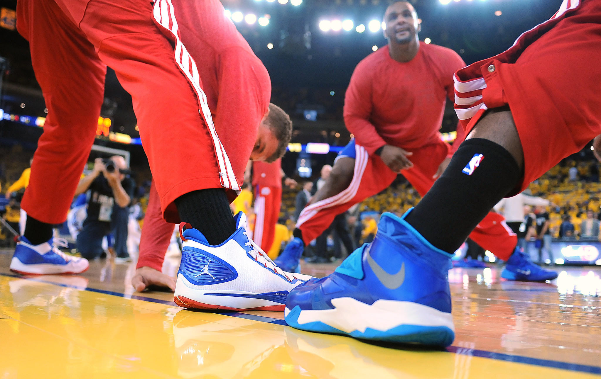 Clippers players wearing black socks in a gesture of solidarity Sunday before Game 4 of their first-round playoff series against the Golden State Warriors in Oakland.