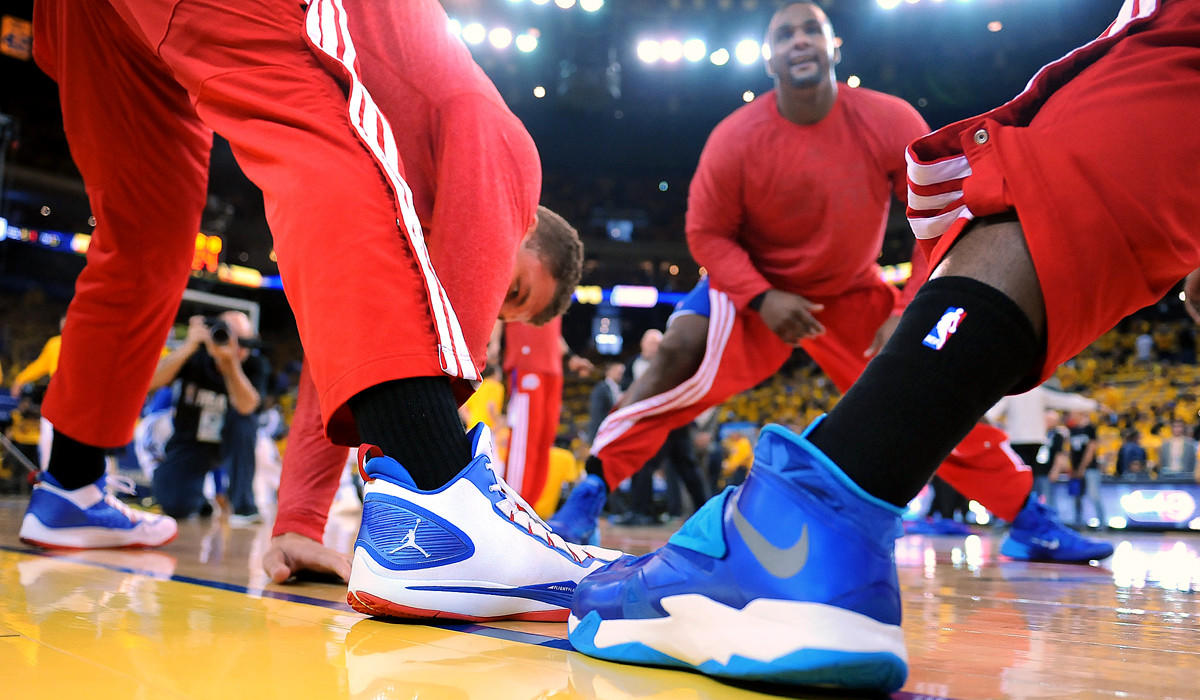 Clippers players sport black socks in a show of solidarity before Game 4 of their playoff series against the Golden State Warriors.