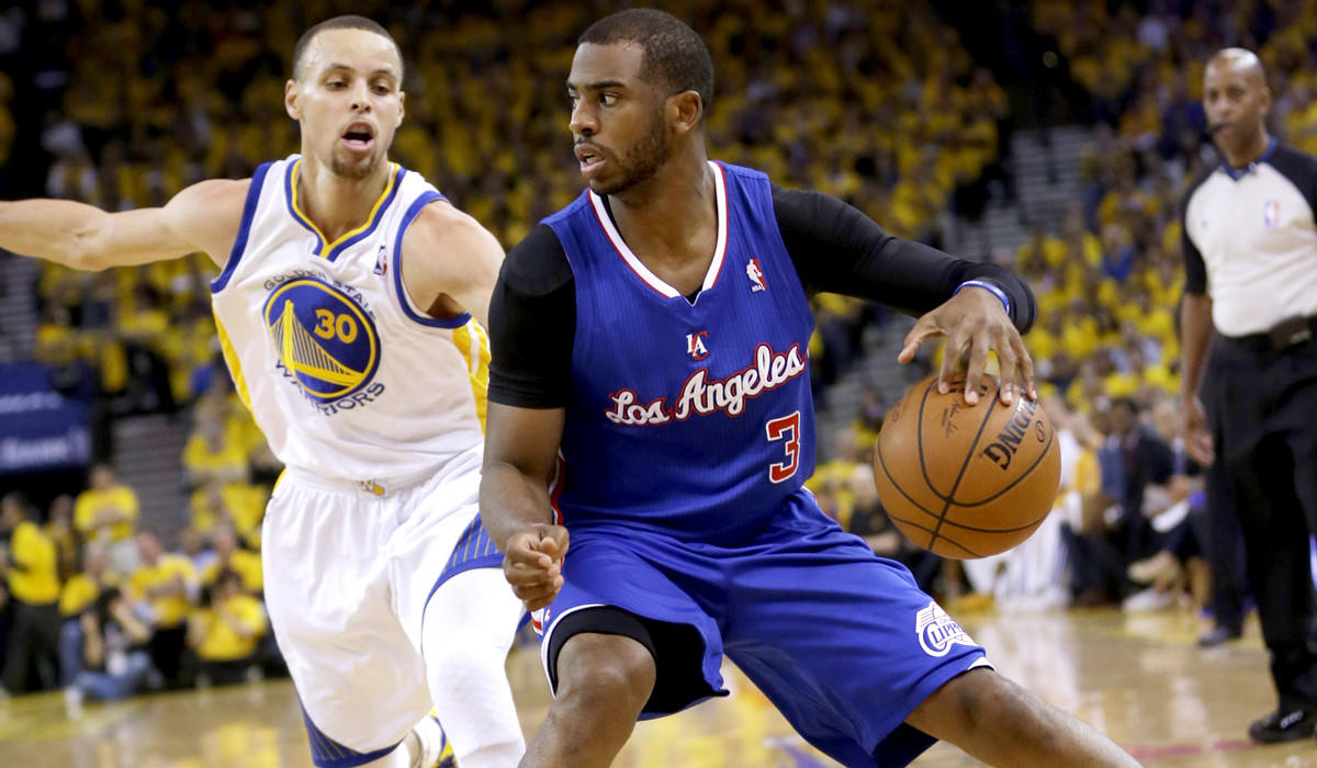 Clippers point guard Chris Paul drives against Warriors point guard Stephen Curry in the first half of Game 4 on Sunday in Oakland.