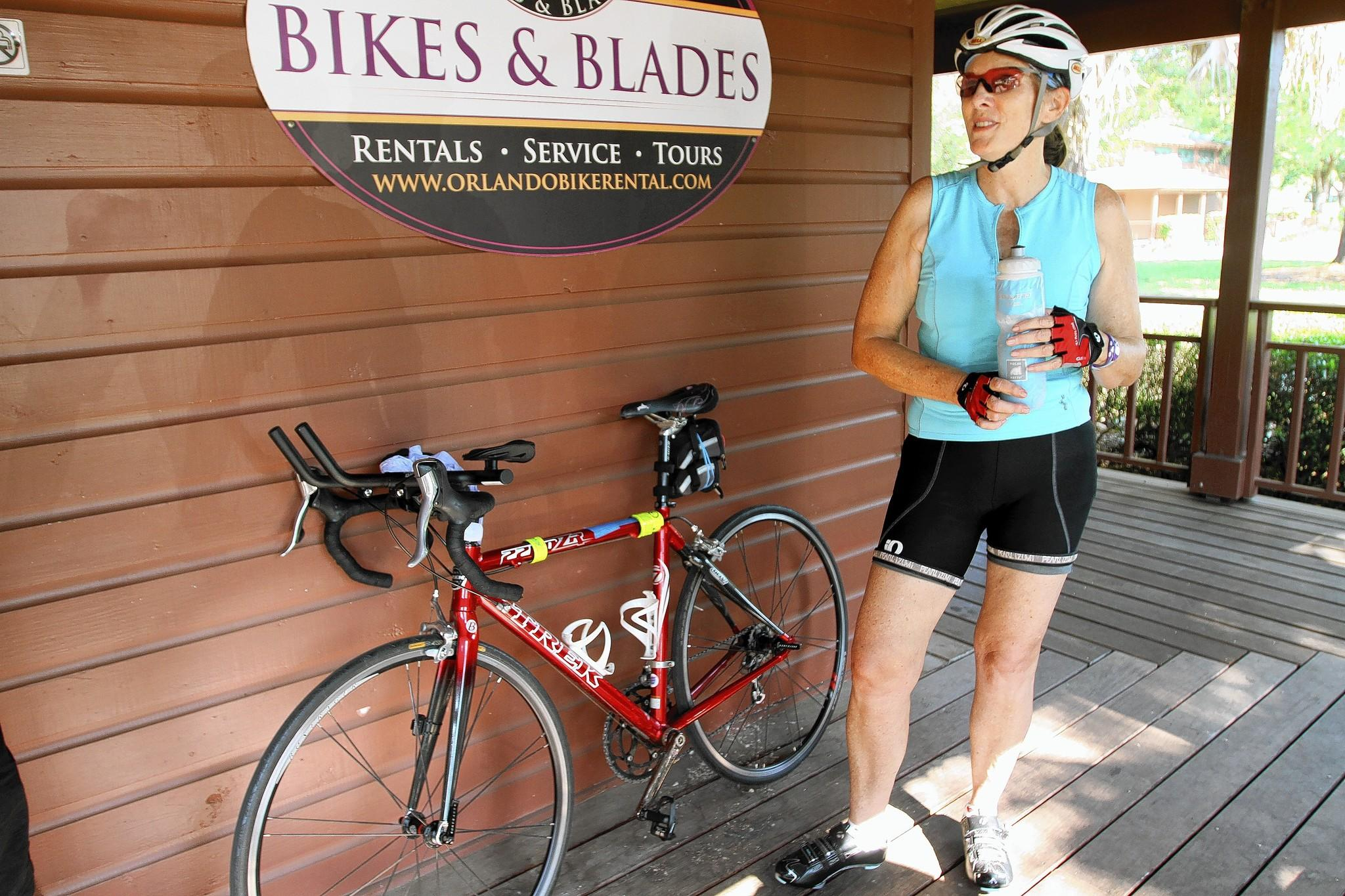 Jody Weiss takes a break during her 50-mile bike ride on the West Orange Trail.