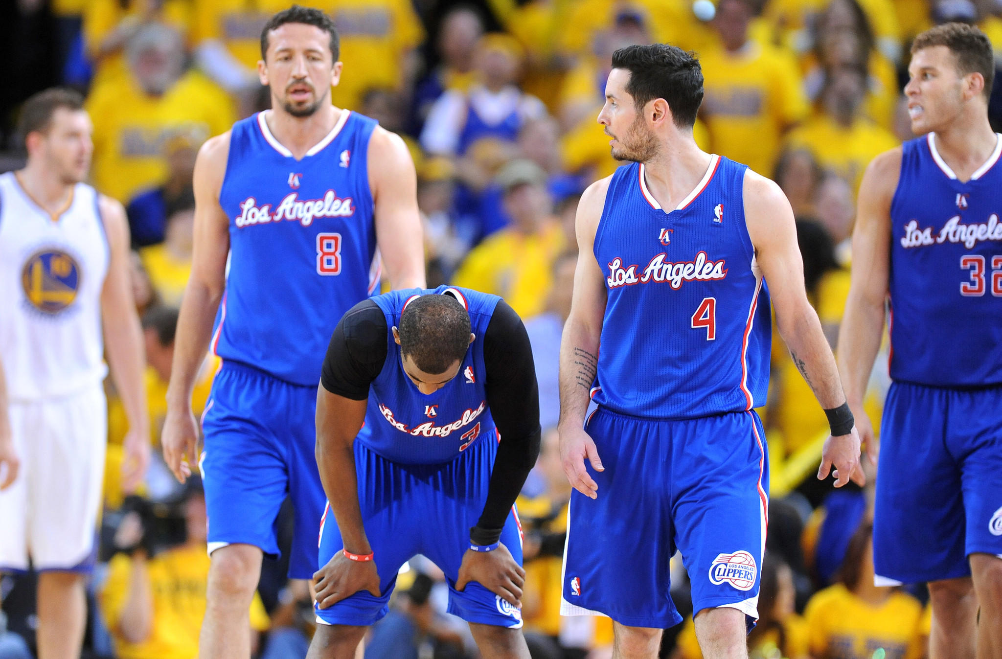Clippers point guard Chris Paul, second left, catches his breath alongside teammates (from left to right) Hedo Turkoglu, J.J. Redick and Blake Griffin following a turnover during the Clippers' 118-97 loss to the Golden State Warriors in Game 4 of the Western Conference quarterfinals.