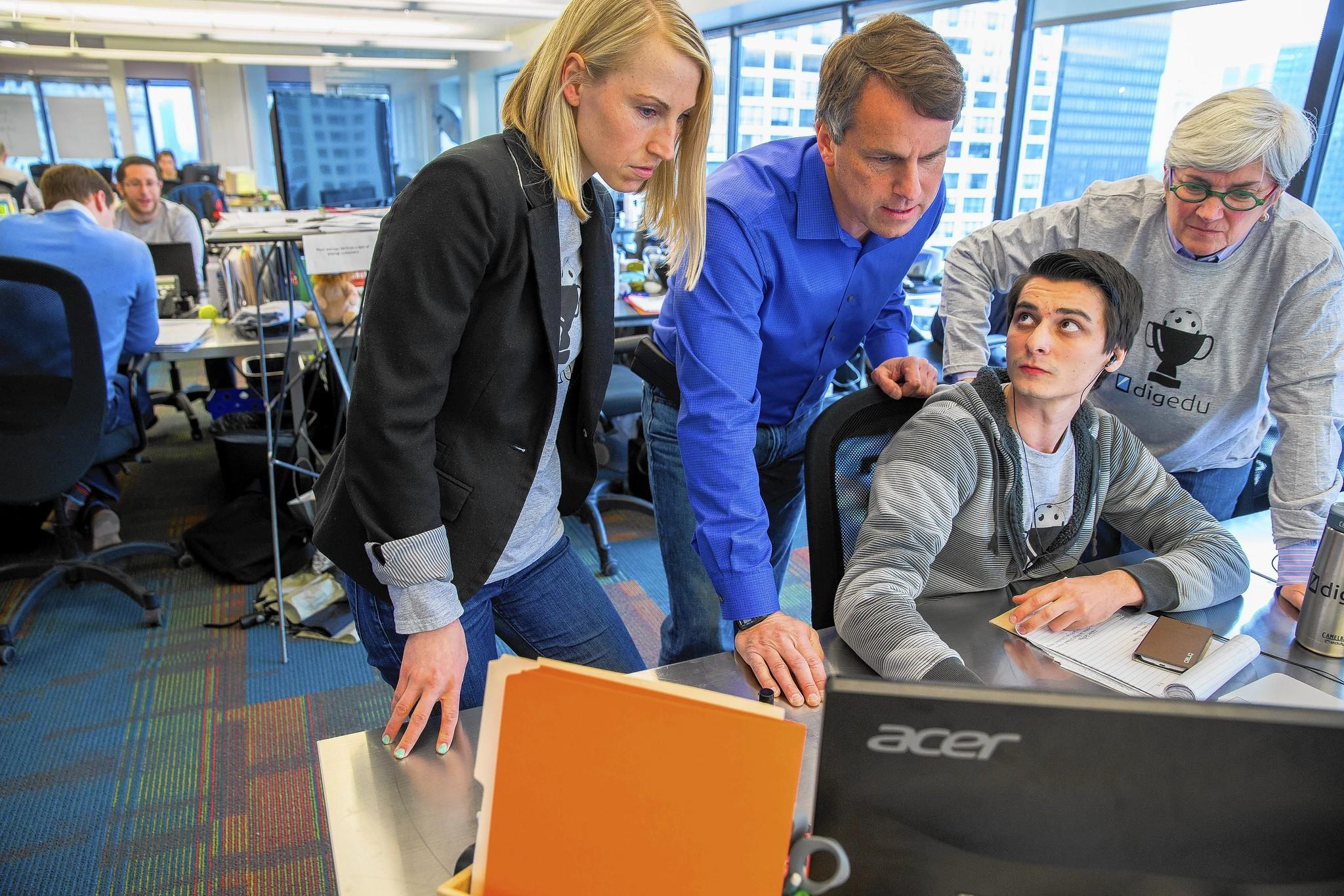 7wire Ventures co-founder and managing partner Glen Tullman, second from left, works at the startup's Chicago office alongside Jennifer Shike, left, Denise Foy, right, and Dennis Briciu.