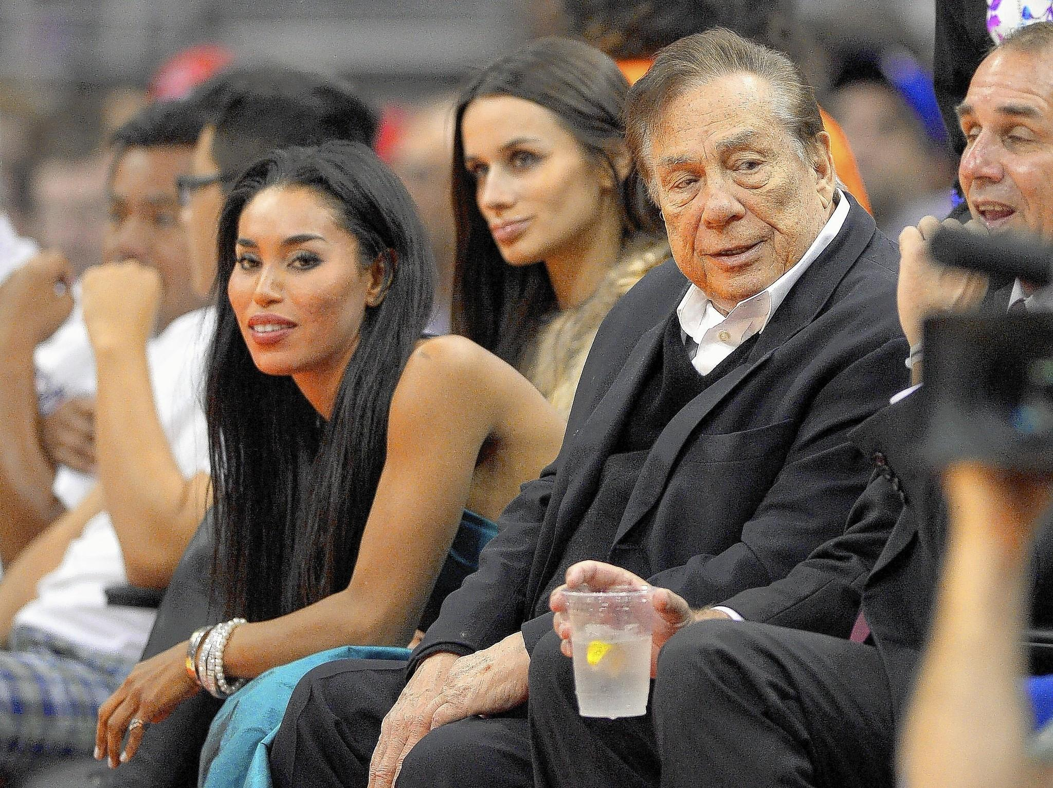 V. Stiviano, left, watches the Clippers with owner Donald Sterling in October. Stiviano is being sued by Sterling's wife, who alleges the 31-year-old was in a romantic relationship with her husband, 80.