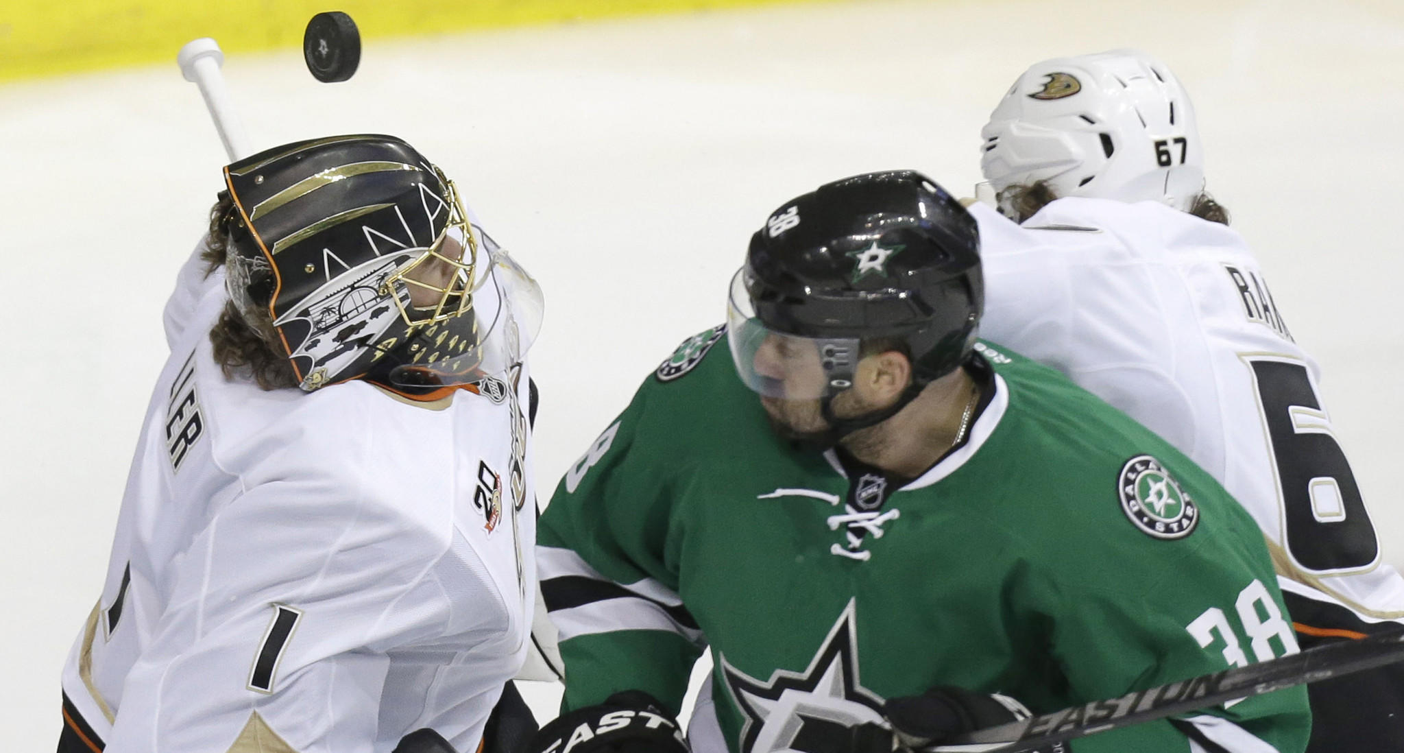 Ducks goalie Jonas Hiller makes a save in front of teammate Rickard Rakell, right, and Dallas Stars forward Vernon Fiddler during the third period of the Ducks' series-clinching 5-4 victory in Game 6 of the Western Conference quarterfinals on Sunday.