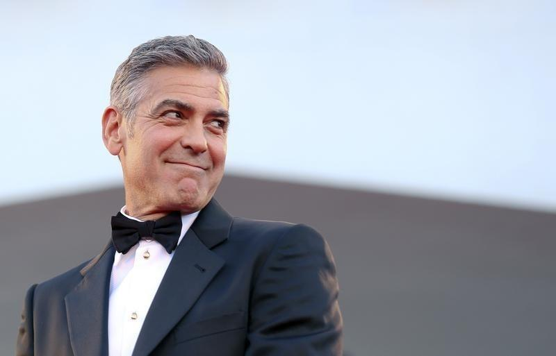 "Actor George Clooney arrives on the red carpet for the premiere of ""Gravity"" at the 70th Venice Film Festival in 2013."