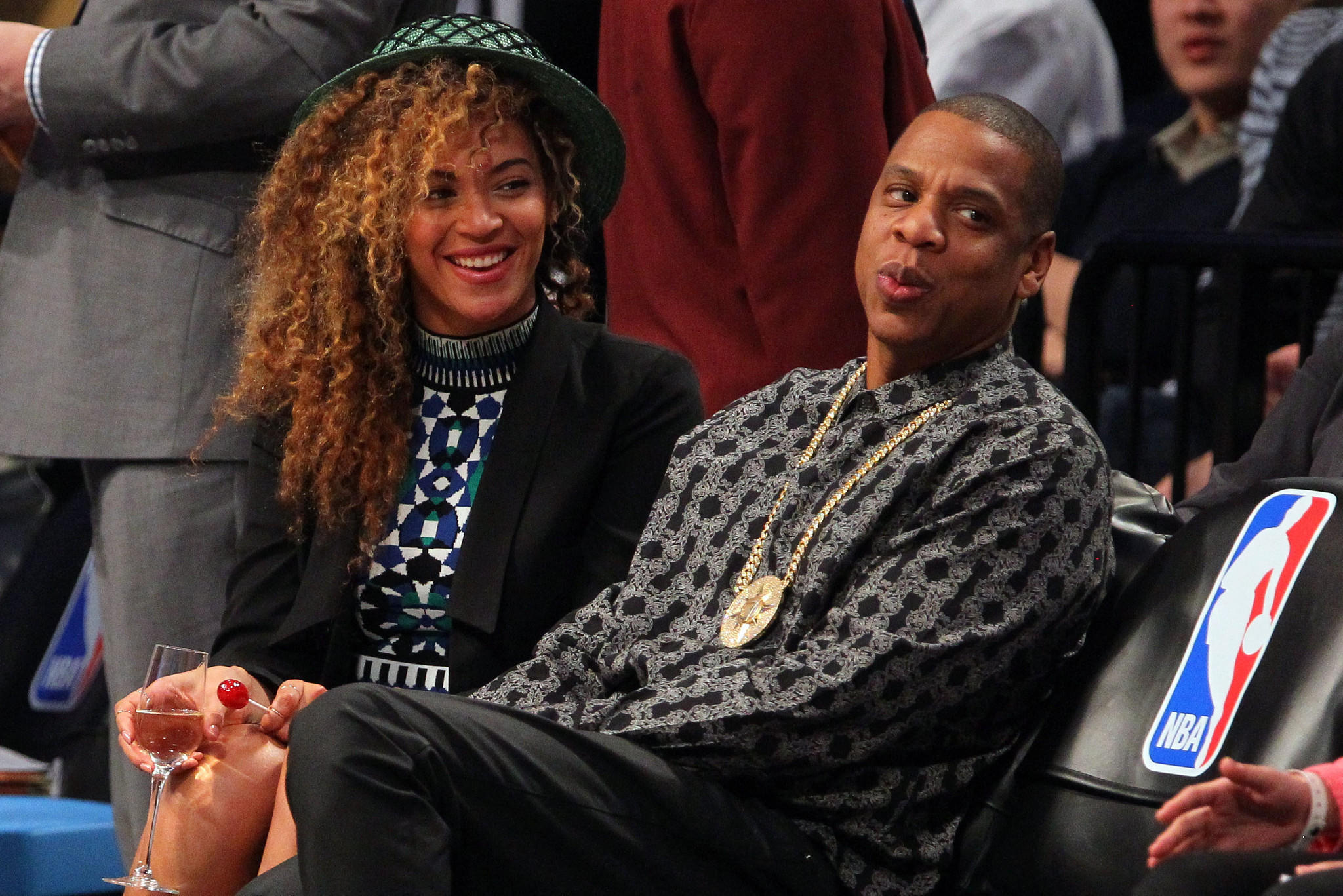 Beyonce and Jay Z watch the game between the Brooklyn Nets and the Houston Rockets during the second quarter at Barclays Center.