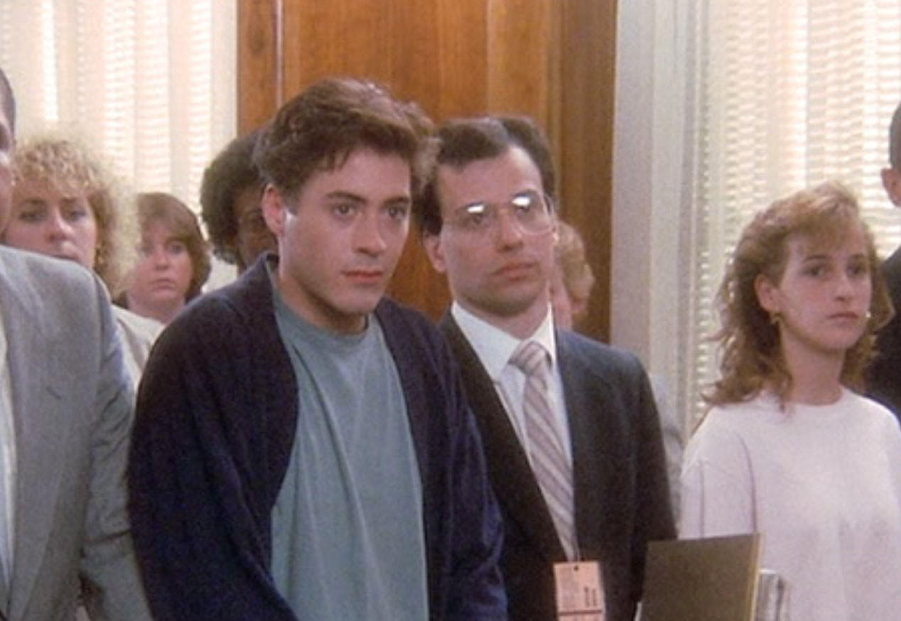 "Del. Ron George of Anne Arundel County, center in glasses, shares the screen with megastar Robert Downey Jr. in the 1989 romantic comedy ""Chances Are."" George, a Republican running for governor, has had a long career as a bit actor."