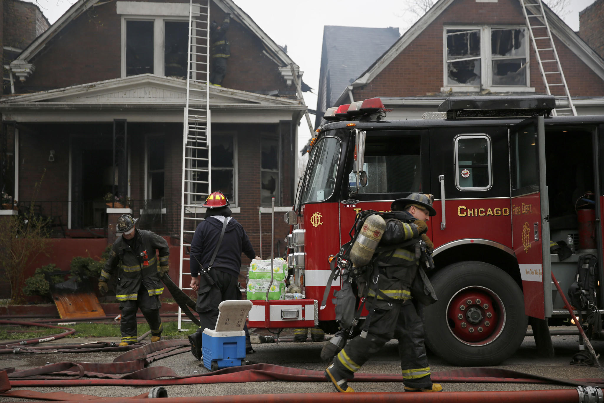 Chicago firefighters work at the scene of an extra-alarm fire in the 6600 block of S. Bishop St. in Chicago.