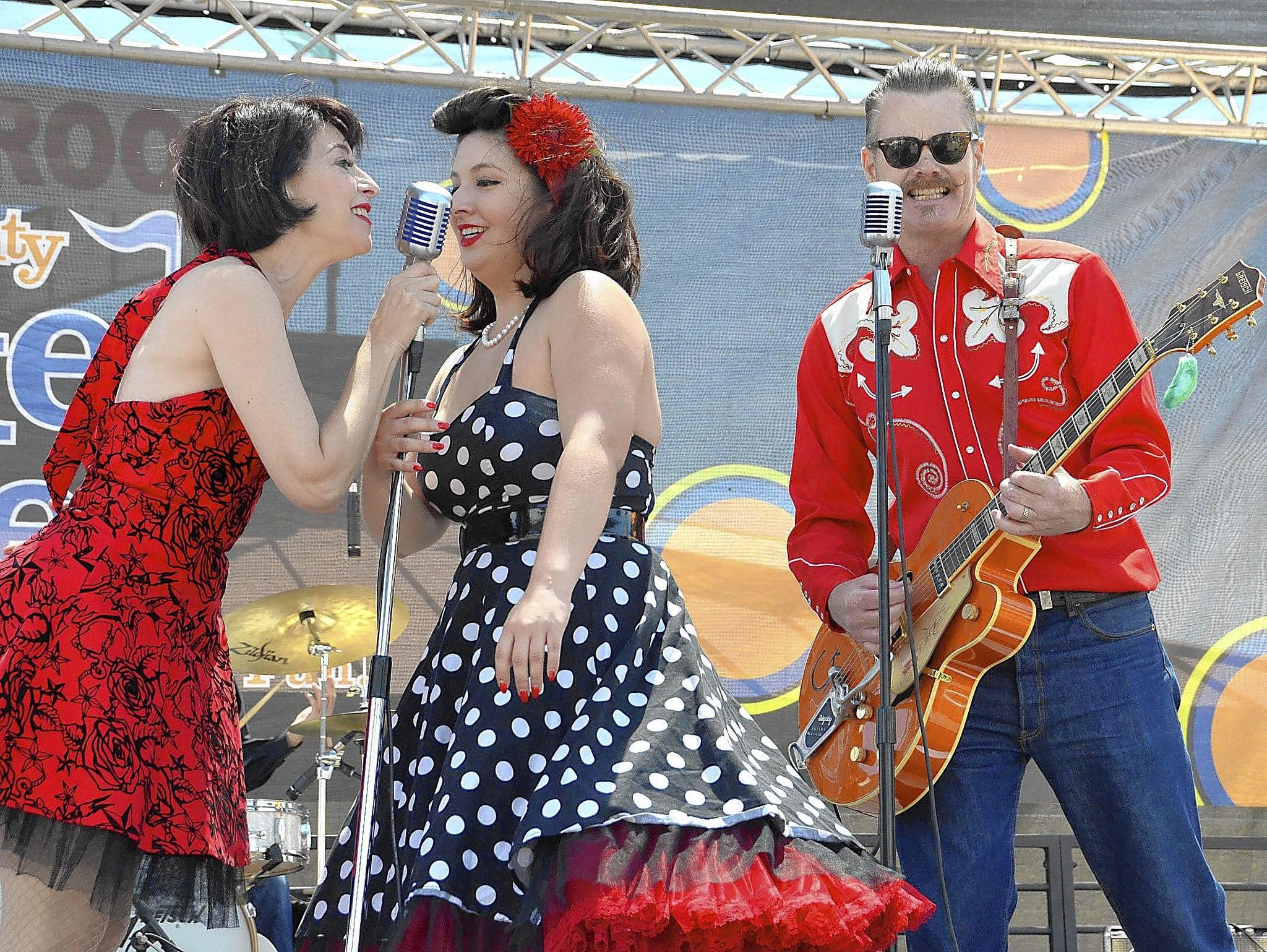 Members of Maureen and the Mercury 5, including Maureen Davis, far left, and guitarist Scott McLean, right, perform a swinging set of '50s rock 'n' roll in the style of Ann Margaret and Elvis, during the fifth annual West Coast Rockabilly Showdown competition at the OC Marketplace on Saturday afternoon. The event features eight unsigned and independent rockabilly bands who compete for $3,000.