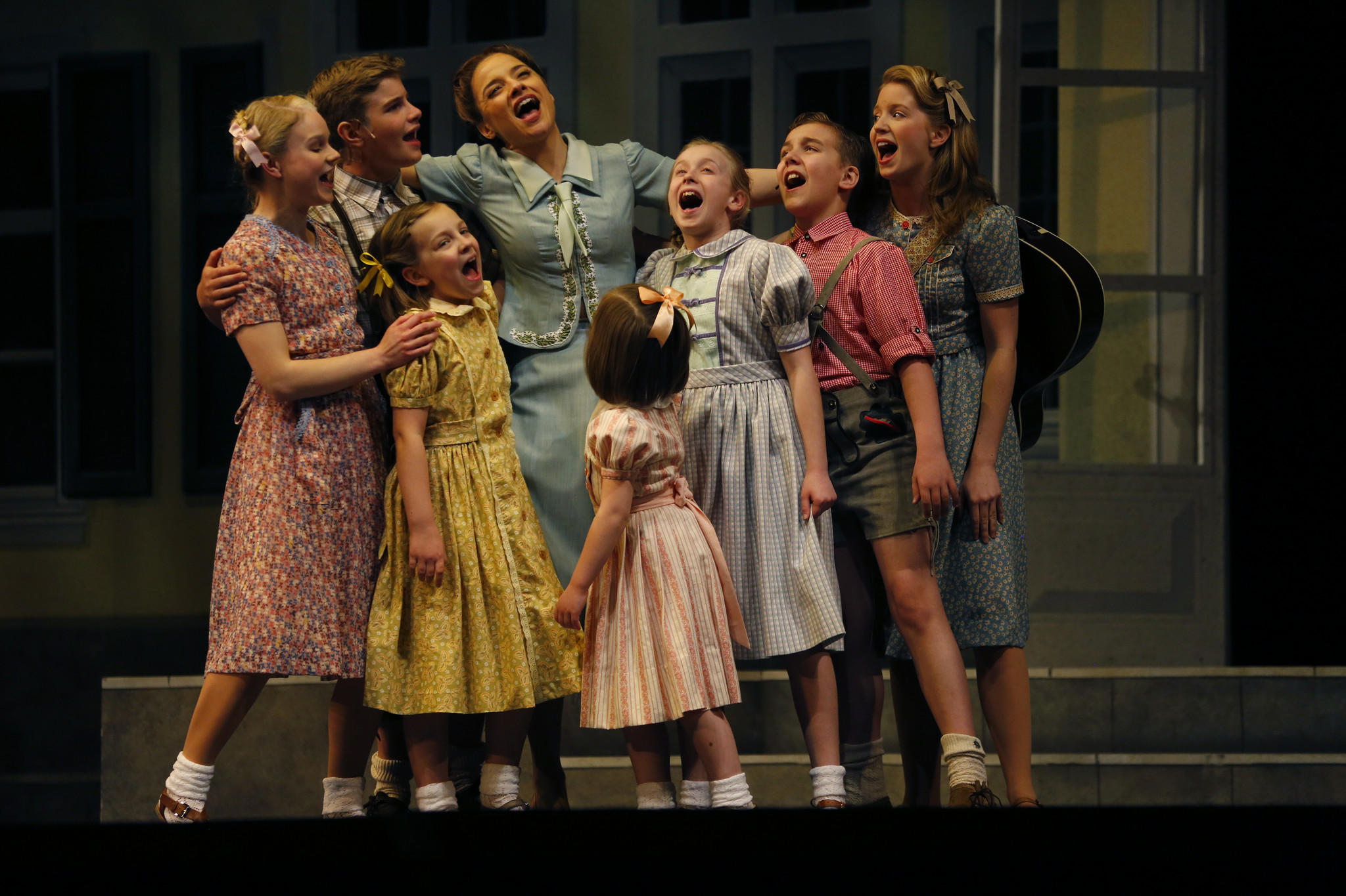 """In Act Two, Jenn Gambatese, fourth from left, as Maria, sings with the von Trapp children after being reunited Thursday, April 24, 2014 in a dress rehearsal of """"The Sound of Music"""" at Lyric Opera of Chicago."""