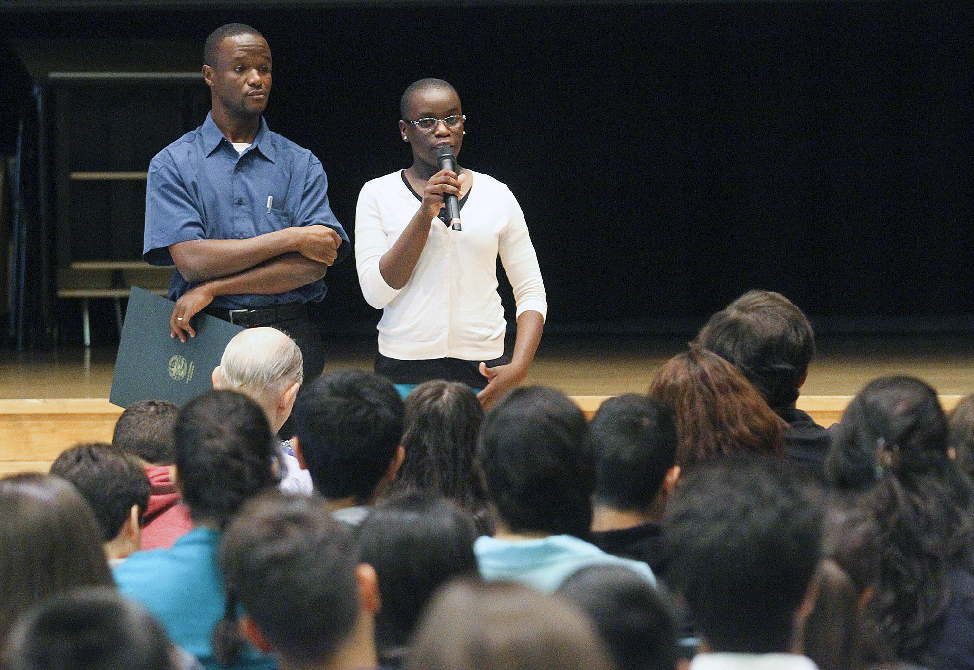 Chess champion Phiona Mutesi, of Uganda, talks with students, answering questions, with her coach Robert Katende at Clark Magnet High School in Glendale on Monday, April 25, 2014. Mutesi grew up in the slums of Uganda and through the game of chess has lifted herself out of the slums onto the international stage for chess and to raise awareness about the plight of her Ugandan people. After her presentation for the students of Clark Magnet, she played against local chess grandmaster Tatev Abrahamyan, of Glendale.