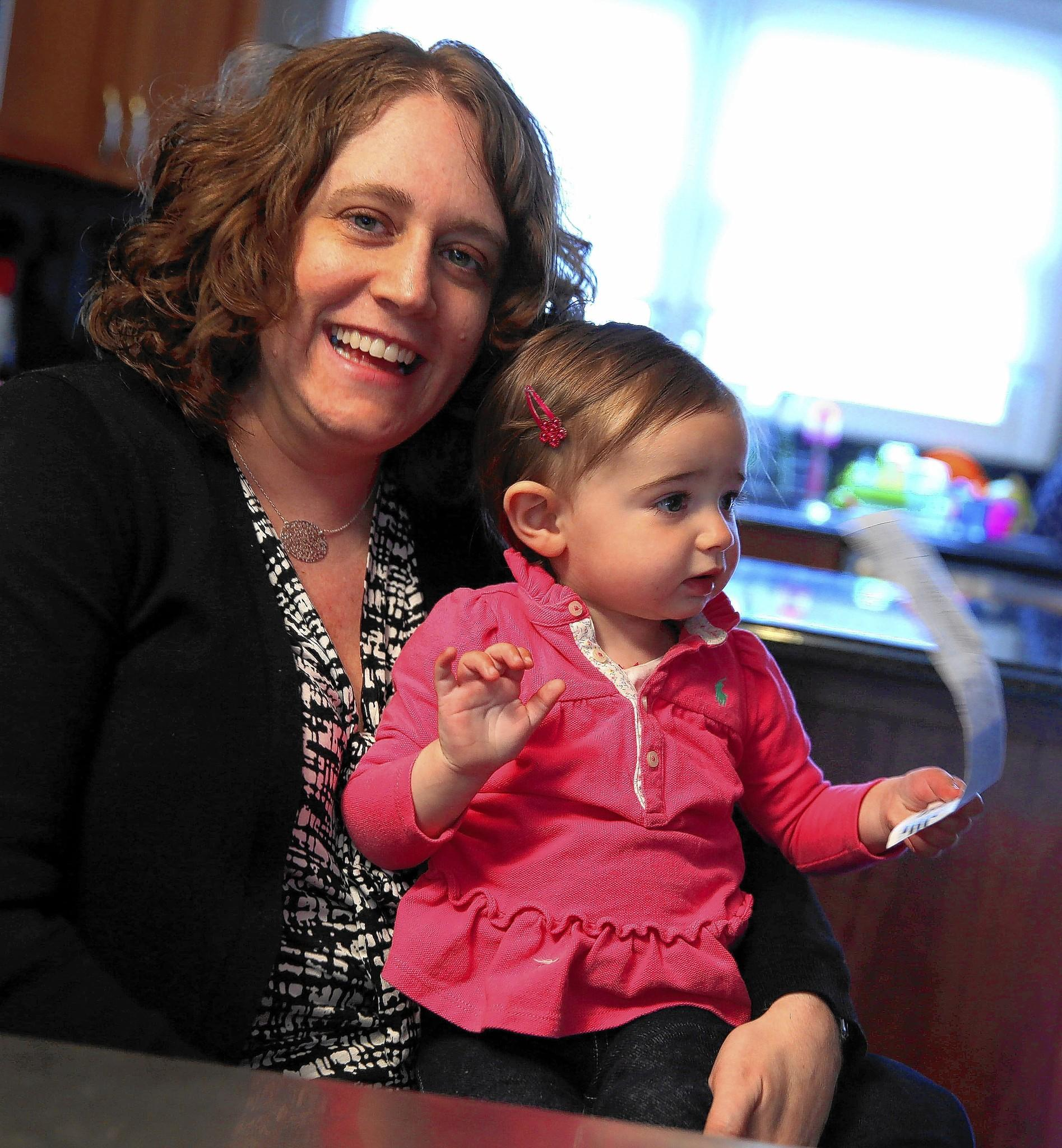 Melissa January, shown with 1-year-old daughter Samantha Brown, couldn't understand why she consistently had about a $43 past-due balance included on her Peoples Gas bill.