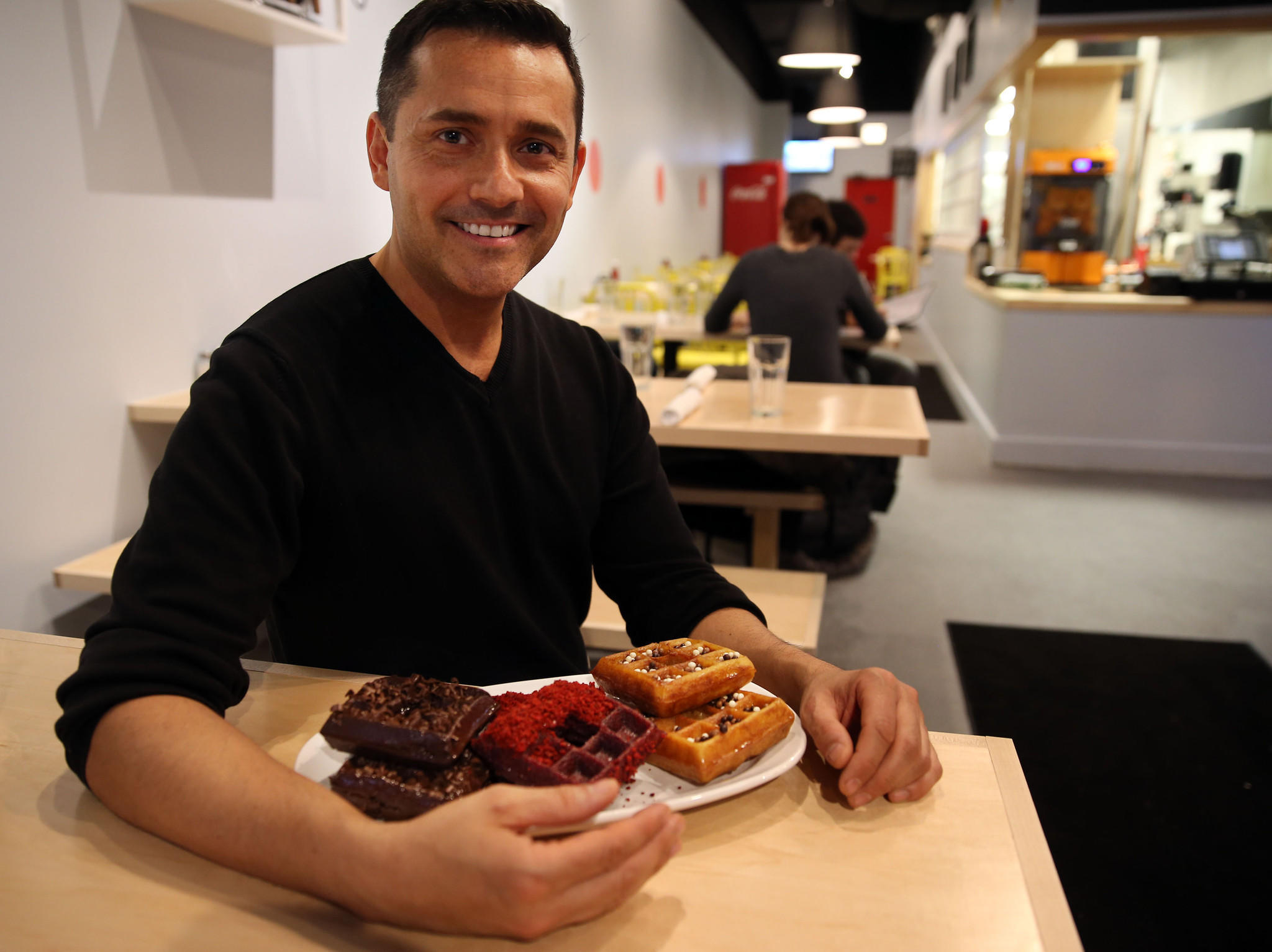 "Alex Hernandez makes ""wonuts,"" a cross between a donut and a waffle, at Waffles Cafe on East Ohio Street in Chicago on Monday, April 28, 2014."