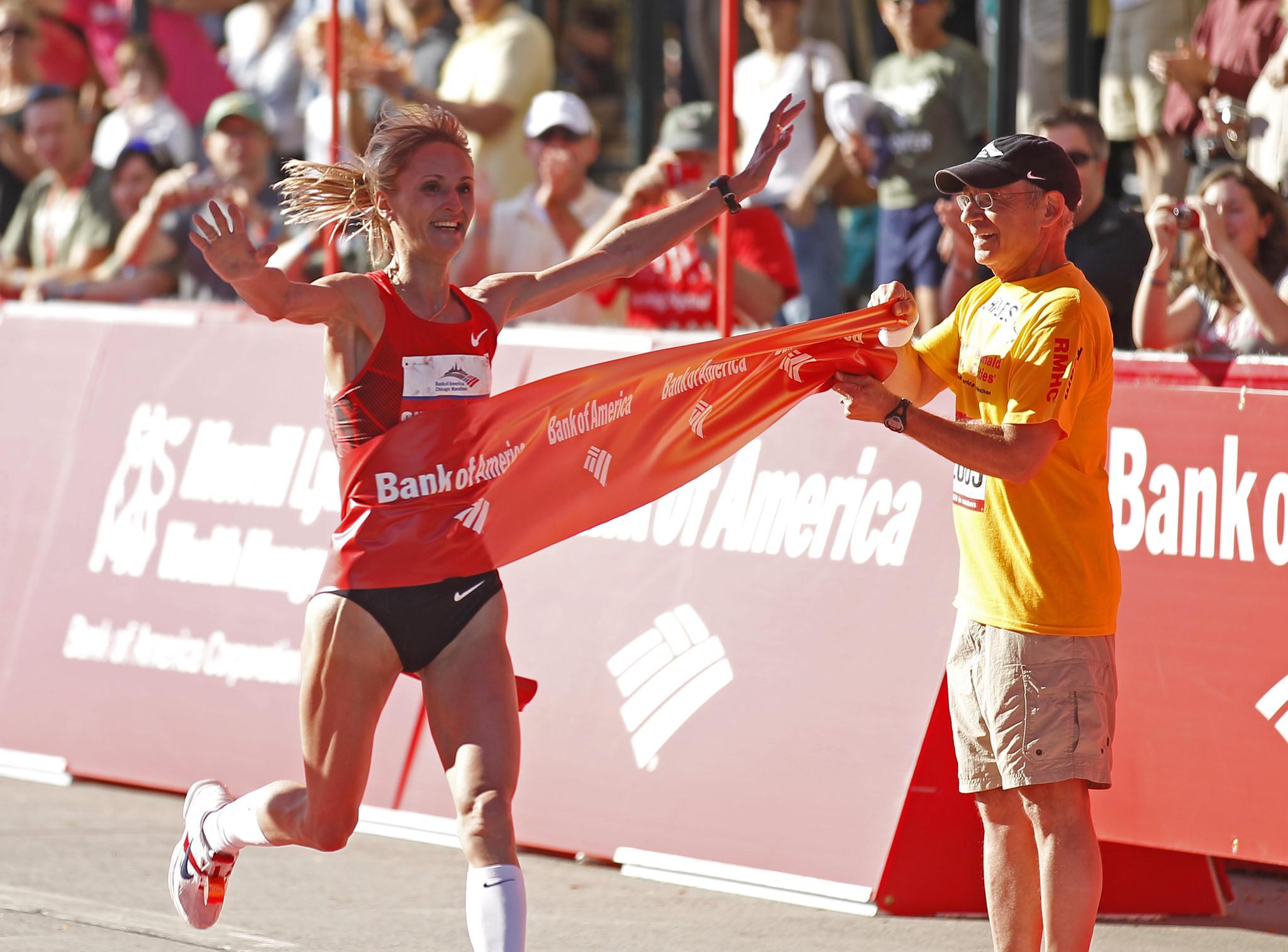Women's winner, Liliya Shobukhova, Russia, crosses the finish line at the Bank of America Chicago Marathon, along Columbus Drive in Grant Park, October 9, 2011