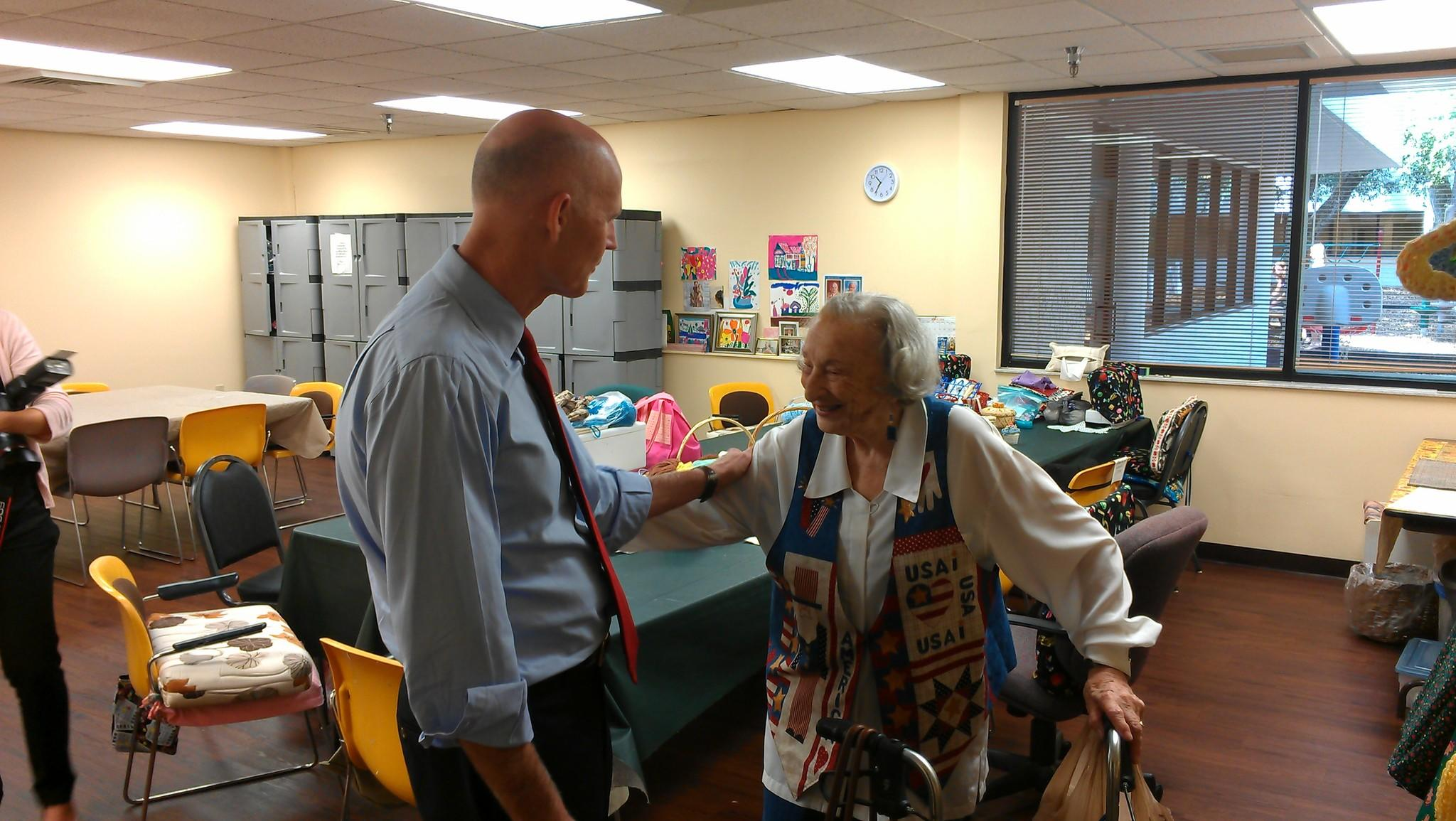 Gov. Rick Scott introduces himself to Hedy Ziegelman, 93, of Delray Beach during a visit to the Volen Center in Boca Raton on Tuesday, April 29. (Photo by Anthony Man)