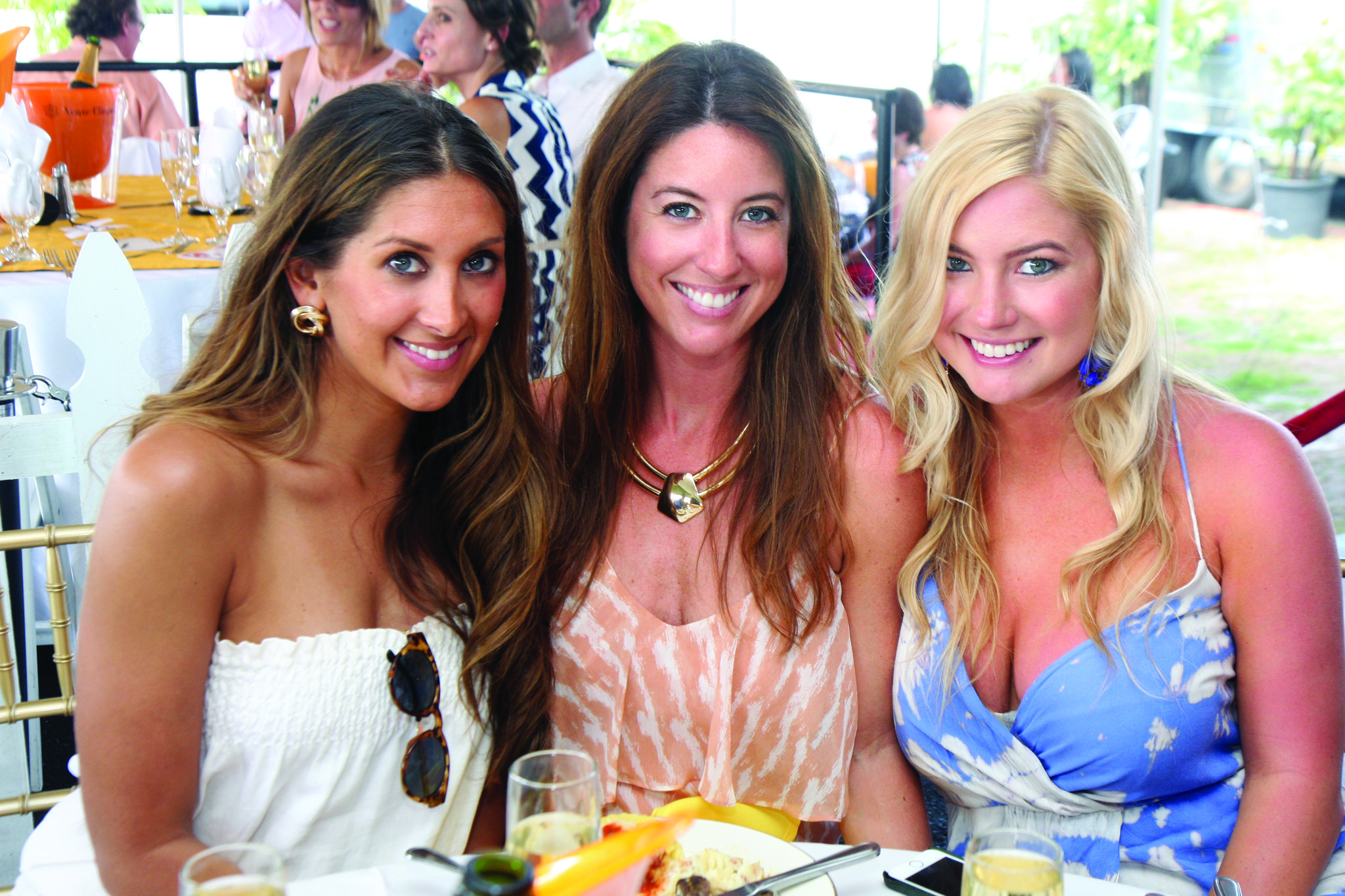 "Society Scene photos - Chrstin Carron, left, Lauren Kukkamaa and Lilly Robbins enjoyed the festivities at ""Sunday Brunch and Polo"" at the International Polo Club."