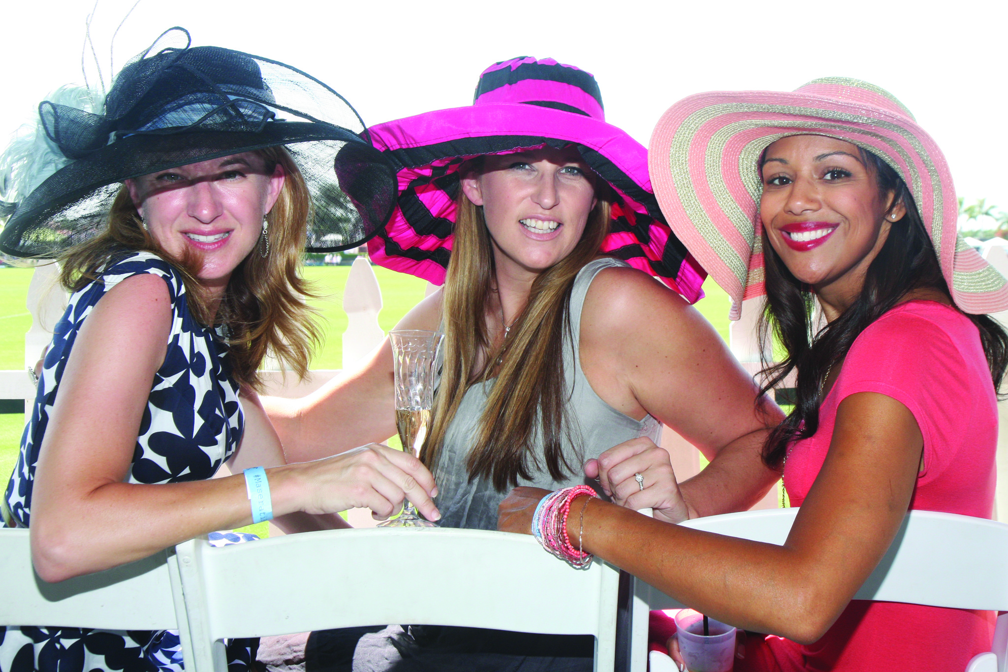"Society Scene photos - Becky Sanders, left, Krista Kowalczyk and Kelly McWilliams look fashionable in colorful hats for ""Sunday Brunch and Polo"" at the International Polo Club. The event benefited The Center for Family Services and featured a ""Fashion on the Field"" halftime competition."