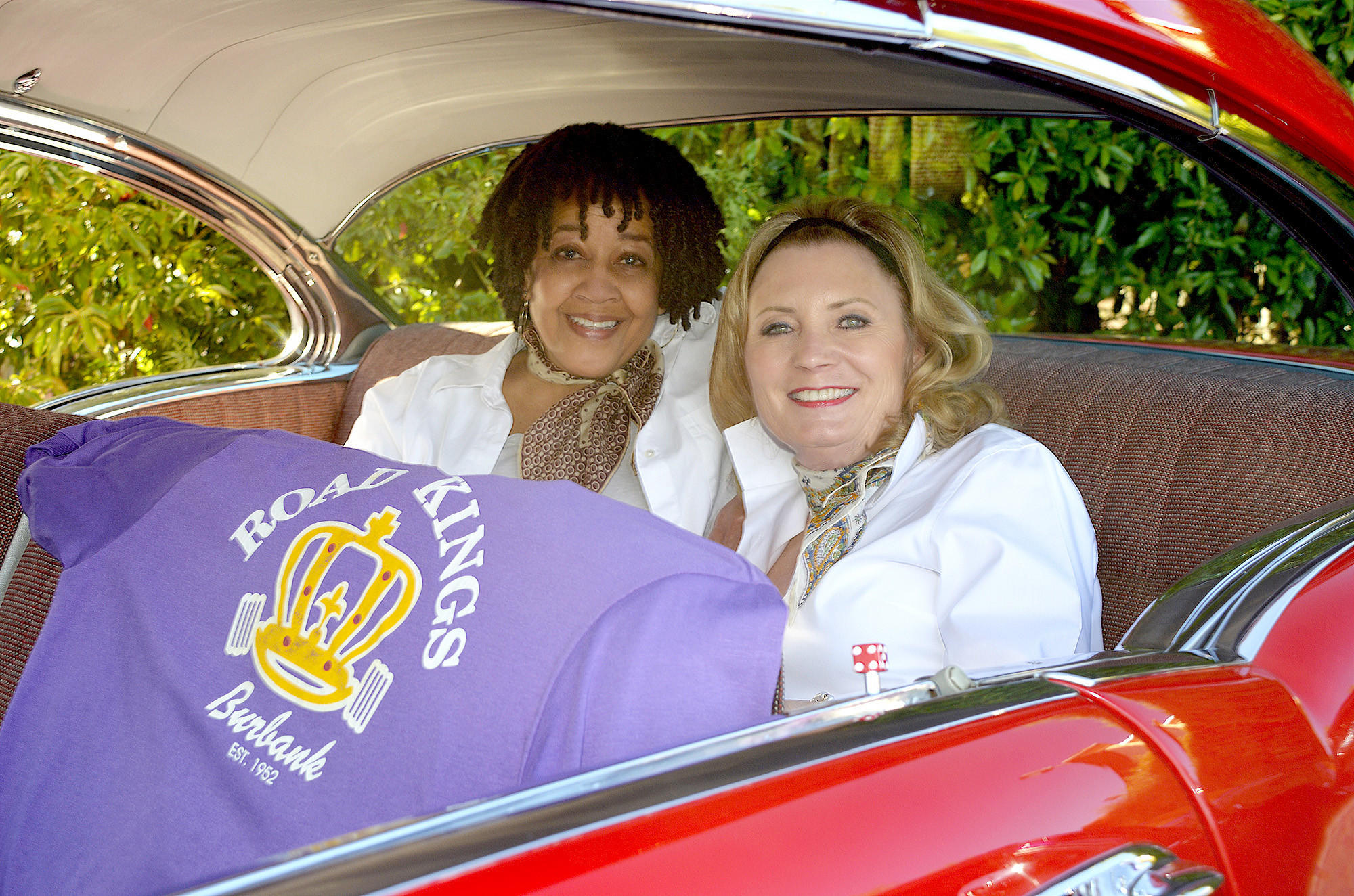 Dorothy Austin, left, and Deborah Spang taking a spin back in time thanks to The Road Kings at Sunday's La Prov fundraiser.