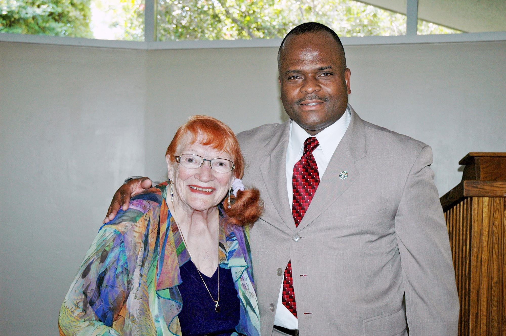 L'aureole President Jeannine Jones with special guest and master of ceremonies Harold Scoggins, Glendale fire chief, during the Perennial Rose Luncheon and Fashion Show at the La Cañada Flintridge Country Club.