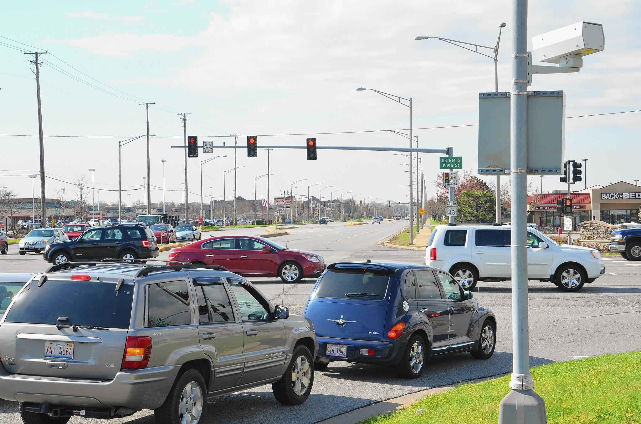 Orland Park is reviewing proposals from companies interested in managing the village's red light cameras. Though violations and revenues have been falling, village officials say the cameras make streets safer and are here to stay.