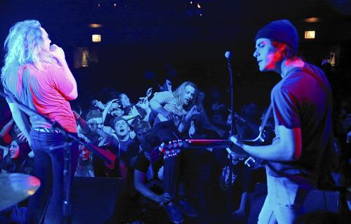 A fan goes body surfing in the crowd during The Orwells concert at Lincoln Hall.