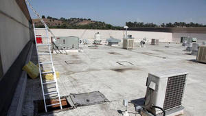 Burglars live the high life off rooftop bank heists