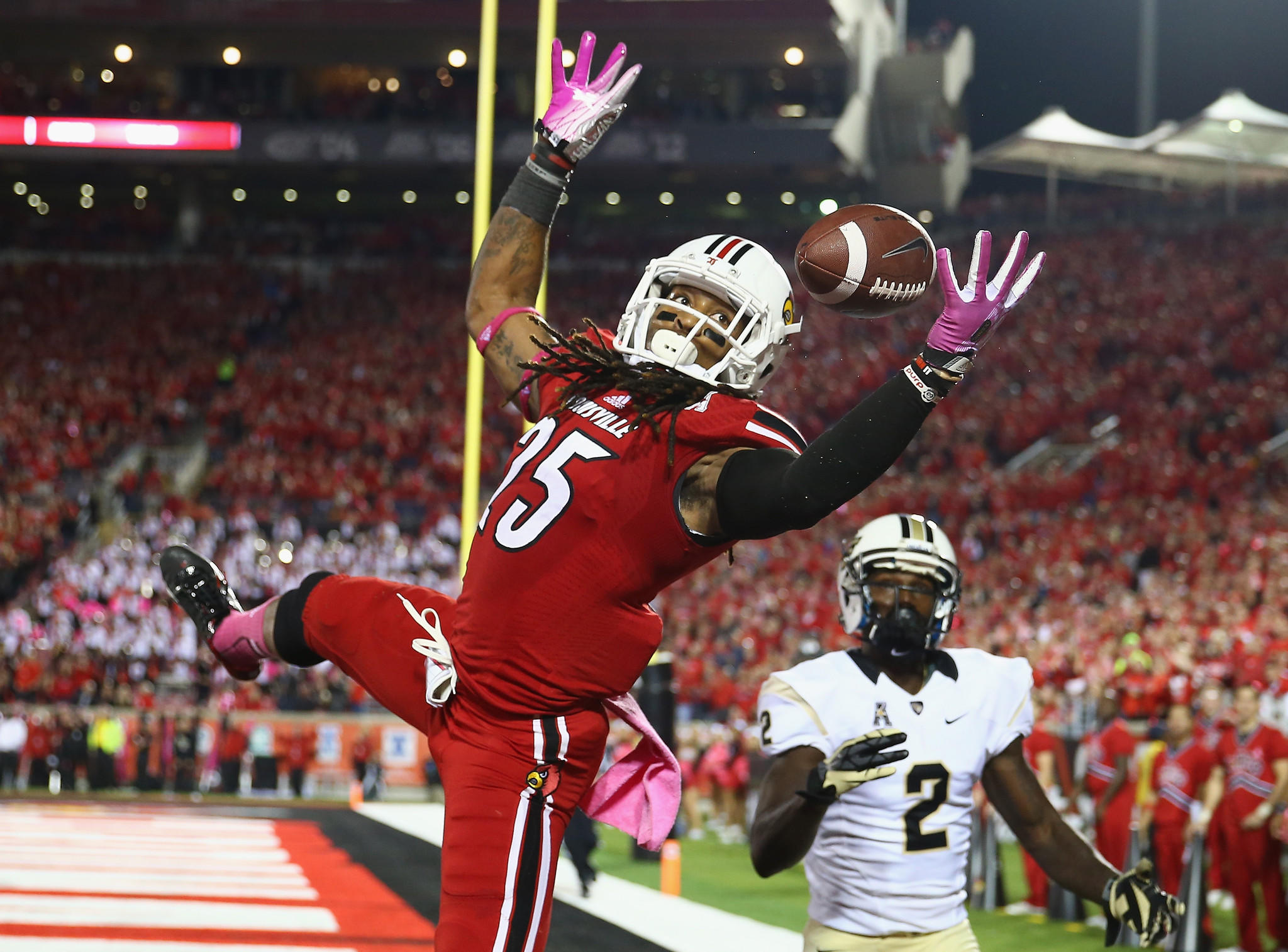 Louisville's Calvin Pryor intercepts a pass in the end zone against Central Florida.