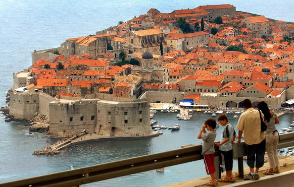 Dubrovnik's Old City, with its red-tiled roofs set against the azure Adriatic, is a UNESCO World Heritage Site.