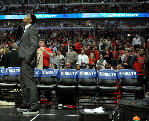 Derrick Rose stands on the sideline during the second half of a Game 5 loss to the Wizards.