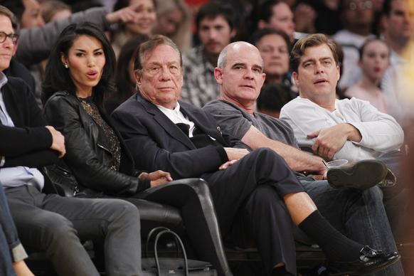 Los Angeles Clippers owner Donald Sterling, right, and V. Stiviano, left, watch the Clippers play the Los Angeles Lakers during an NBA preseason game in December 2010.