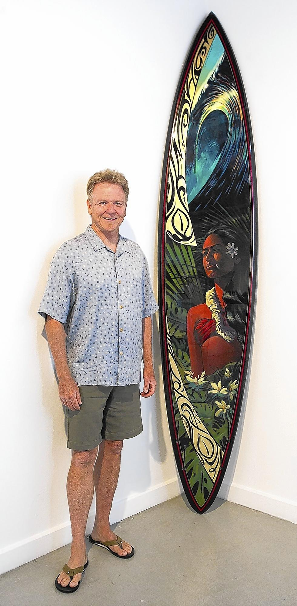 Artist Wade Koniakowsky stands by a board he created with Bill Stewart for an exhibit at the Huntington Beach Art Center.